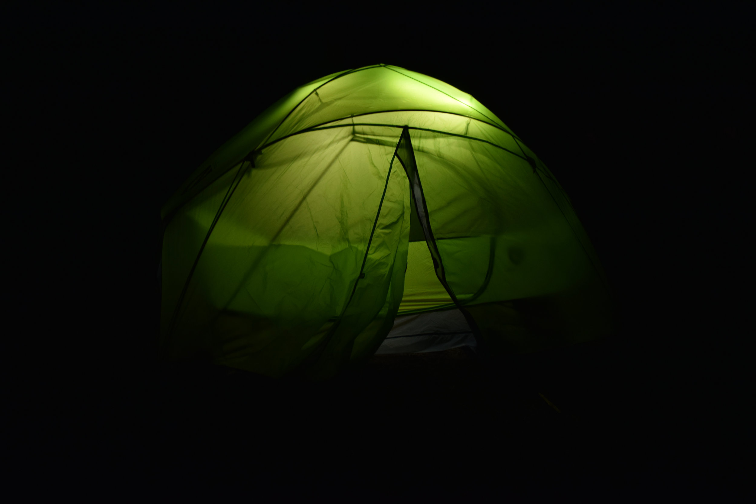 Get a luminoodle! It's a noodle that just plugs into a USB battery. You can hang it in your tent or even wear it on your backpack.