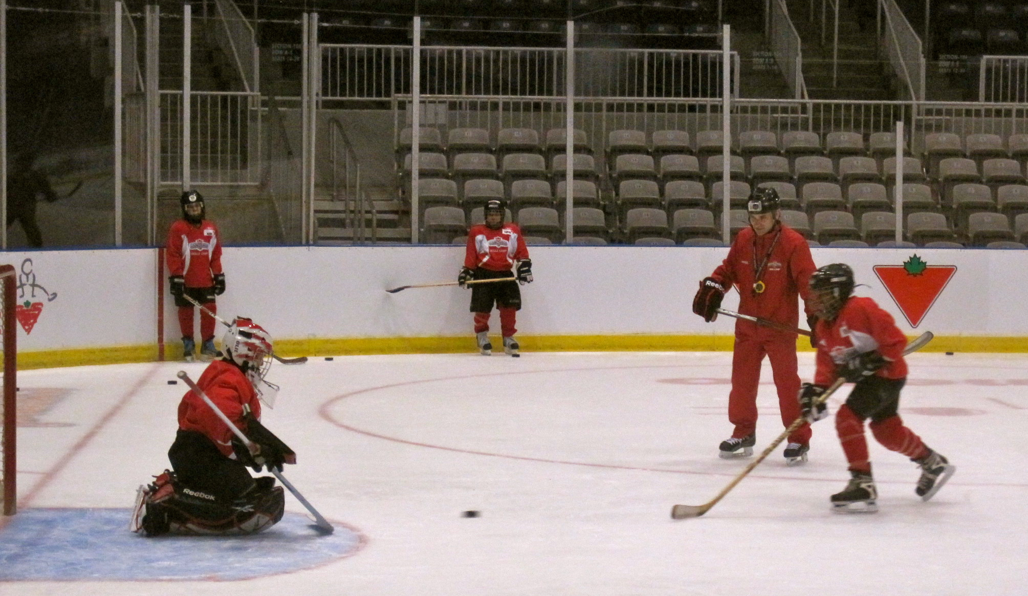 Girls and boys participating in the Canadian Tire Hockey School.