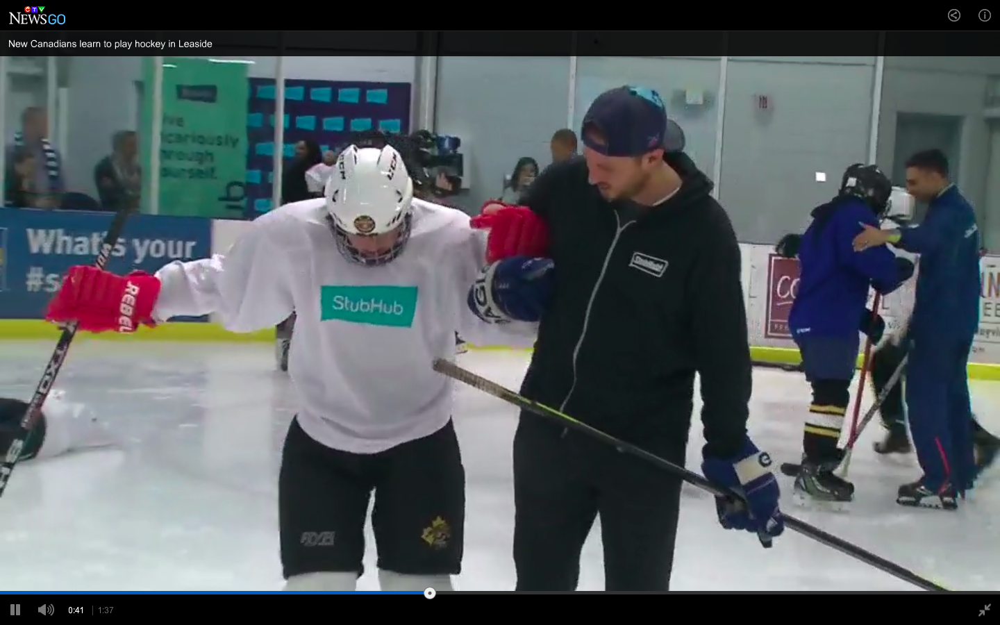 Hockey 4 Youth student gets assistance from StubHub volunteer coach