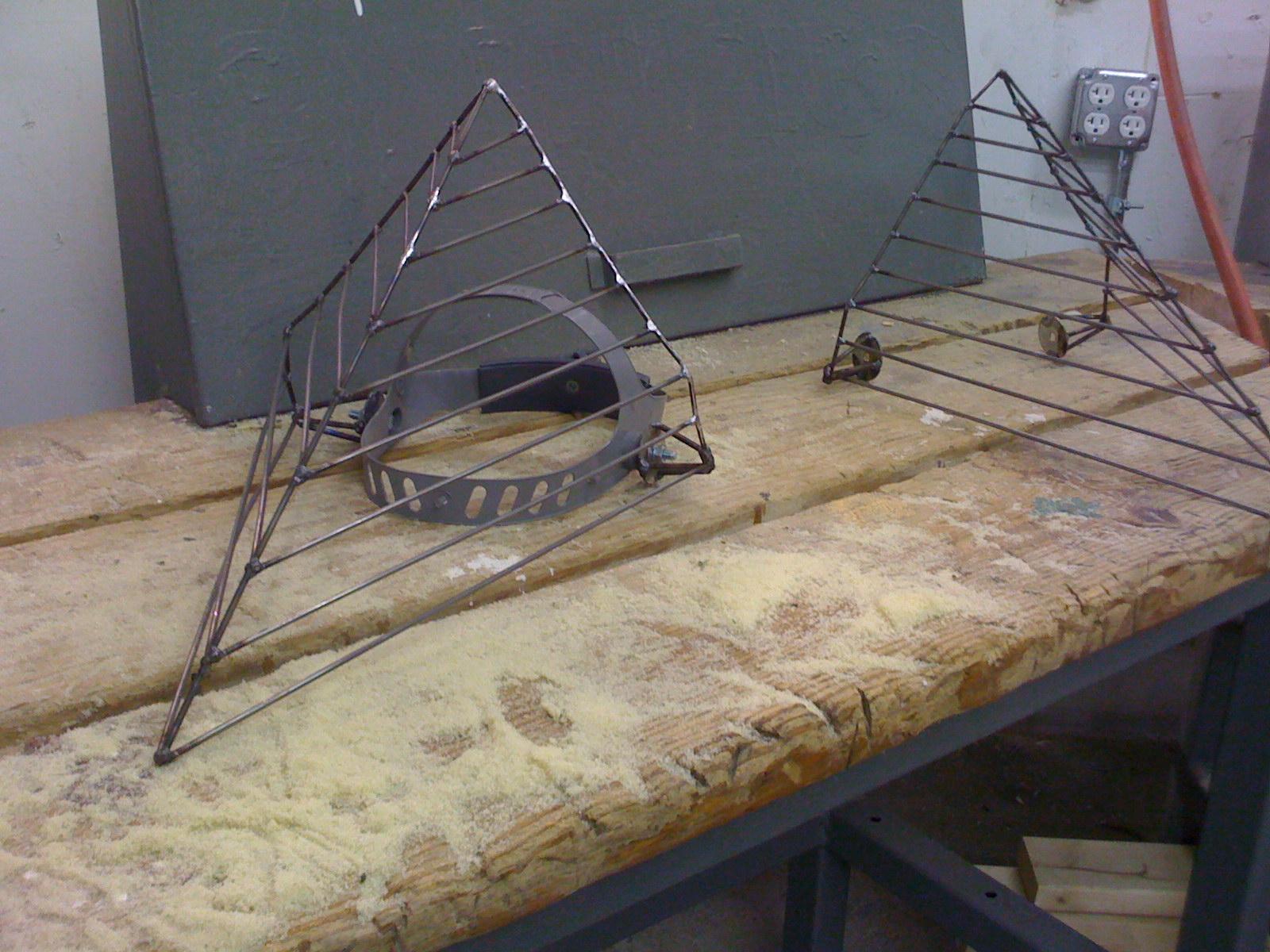 Completed masks in steelwelded by artist Casey Bradley .