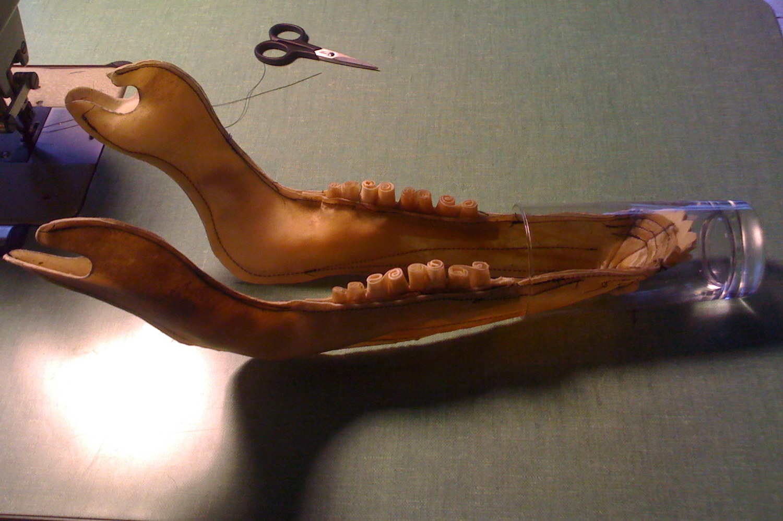 Muskox  rawhide jawbone hardening to shape.