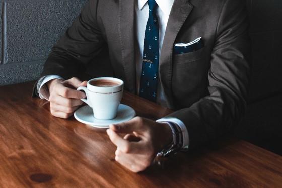 Business man drinking coffee compressed.jpg