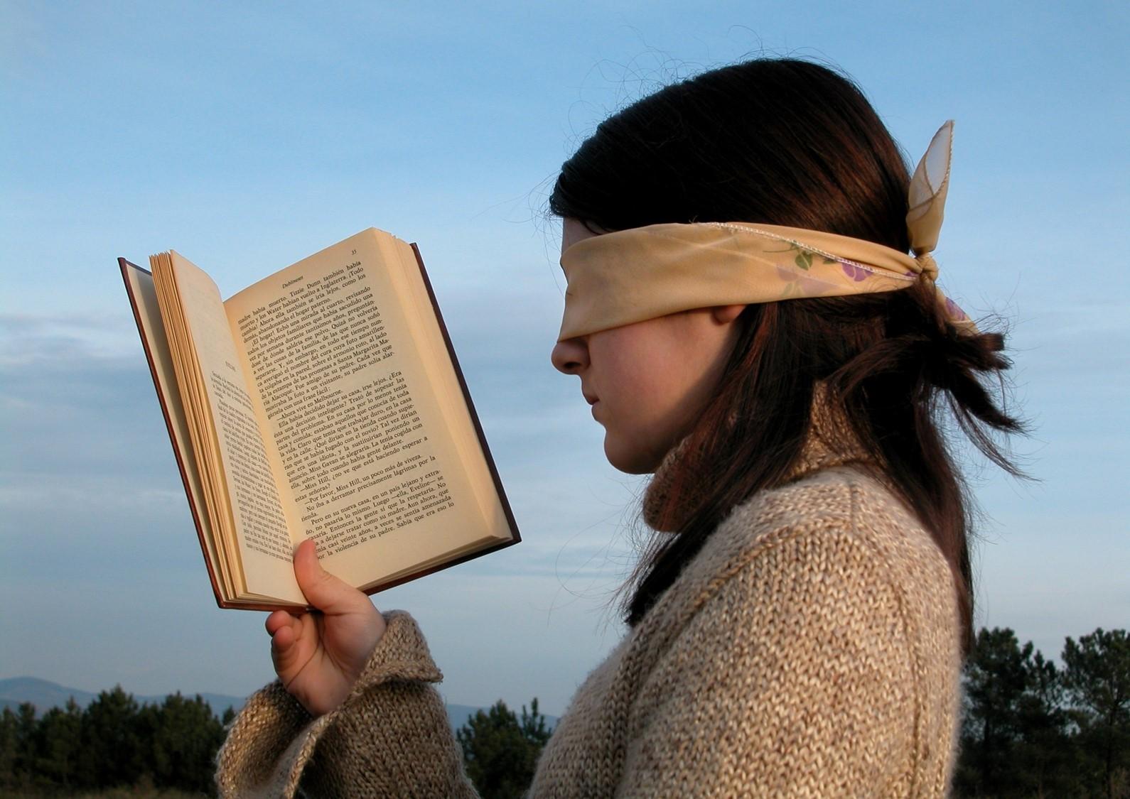 blindfolded book reading compressed.jpg
