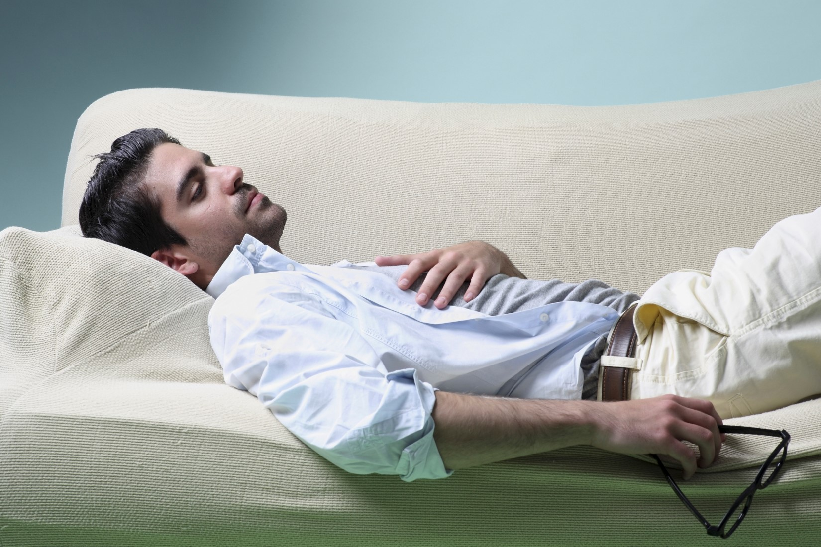 iStock_Man reclining on couch compressed.jpg