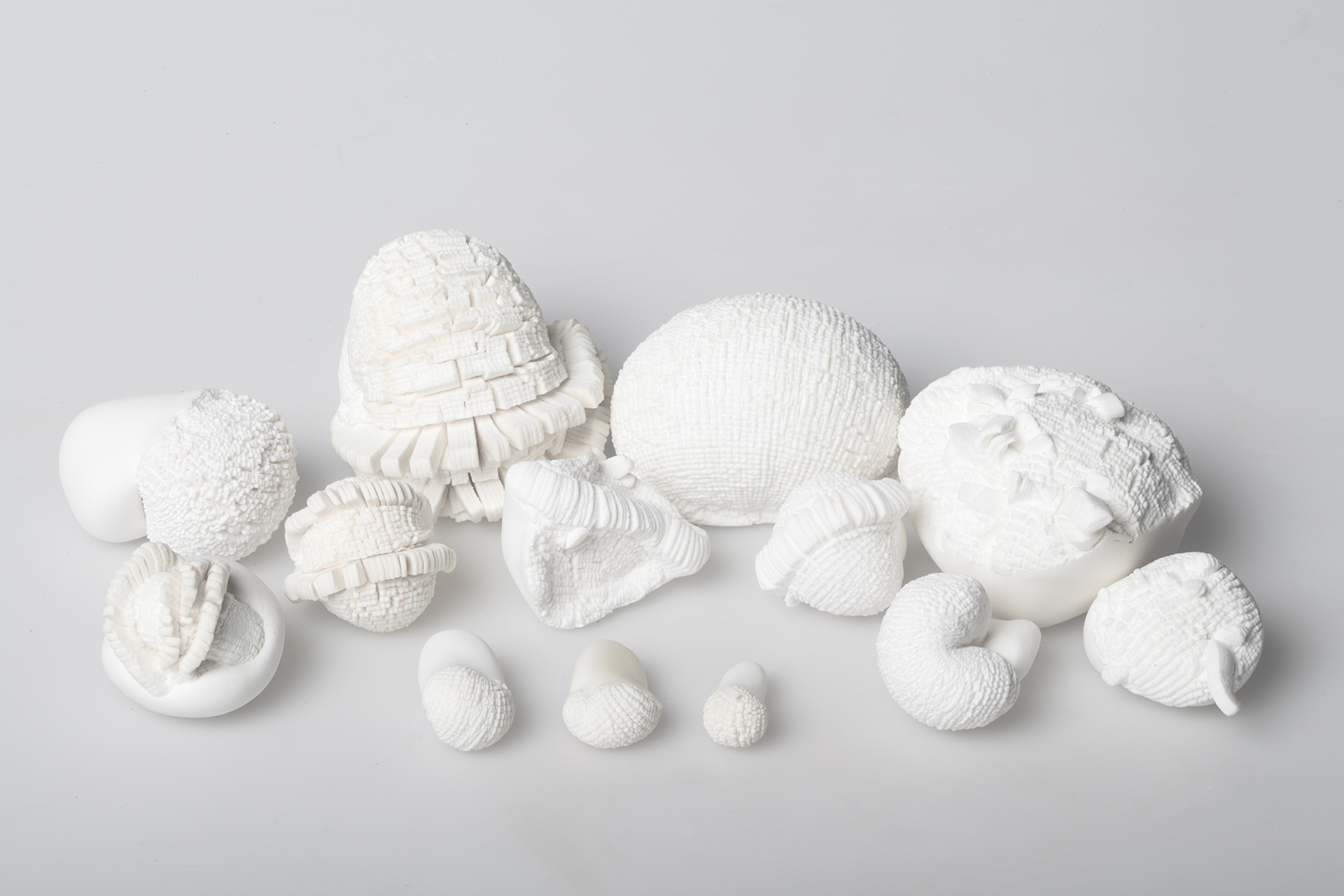 "Small objects with title ""Unanswered questions"" made out of japanese paperclay in 2009."