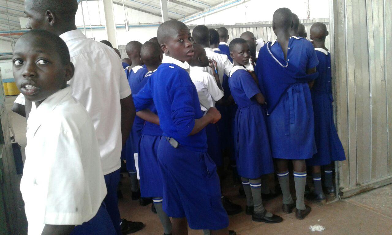 Pupils on a tour of a textile factory.