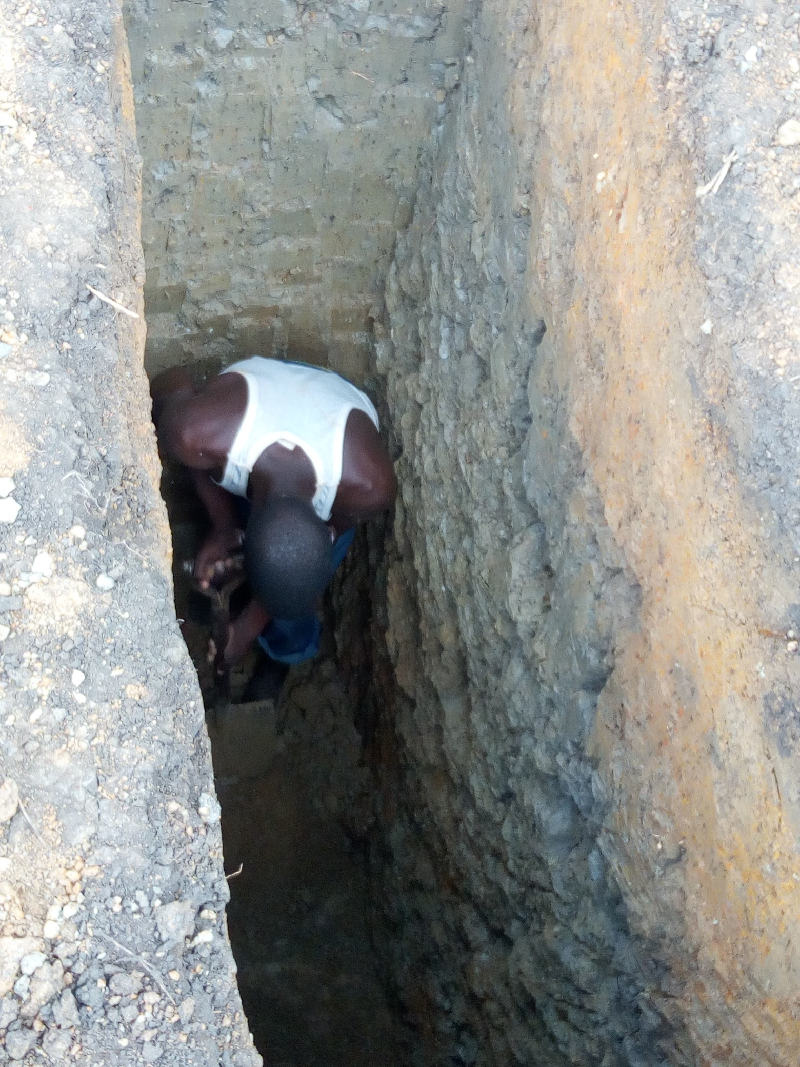 Clinic - Photo dated 25 April showing exploratory pit.jpg