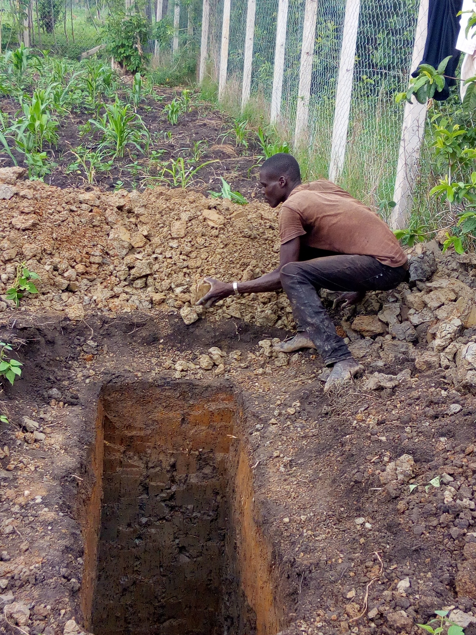 Clinic - Photo dated 25 April  showing exploratory pit to establish soil content and structure.jpg
