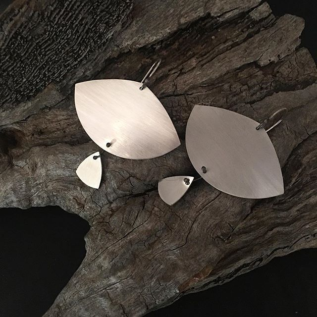 Nice, big, silver, dangly, earrings for your lobes heading into the crazy season. Matte and polished finished to suit any occasion! X