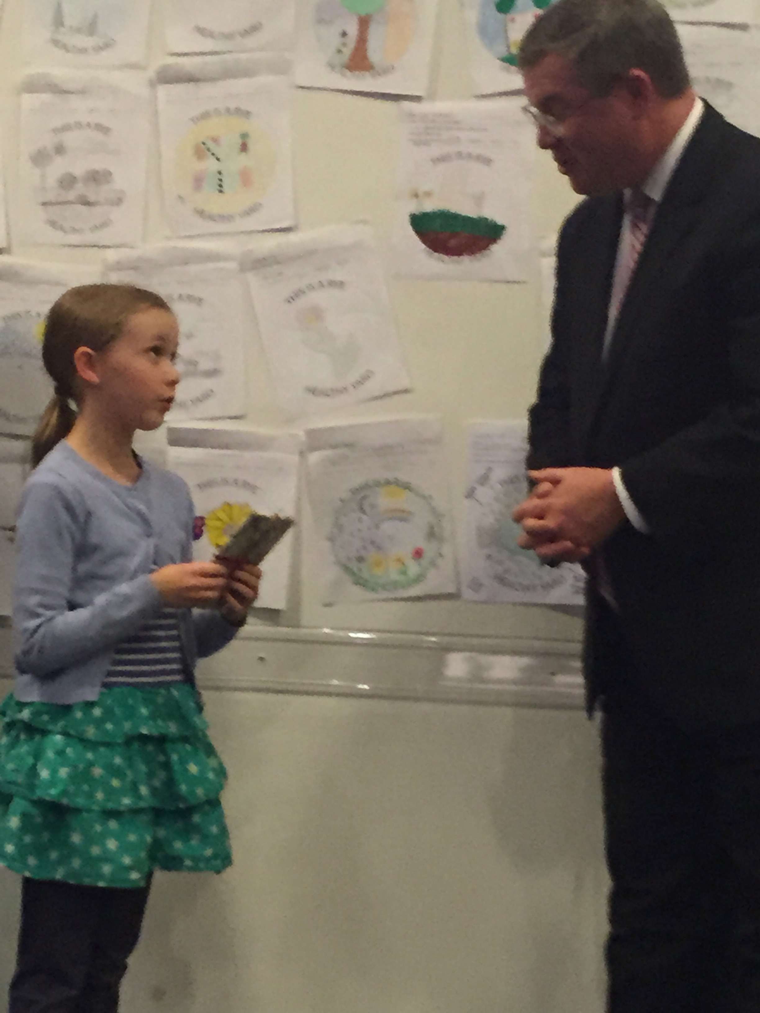Grand Prize winner Liv McNamara explains to Mayor Sack how she came up with the winning design.