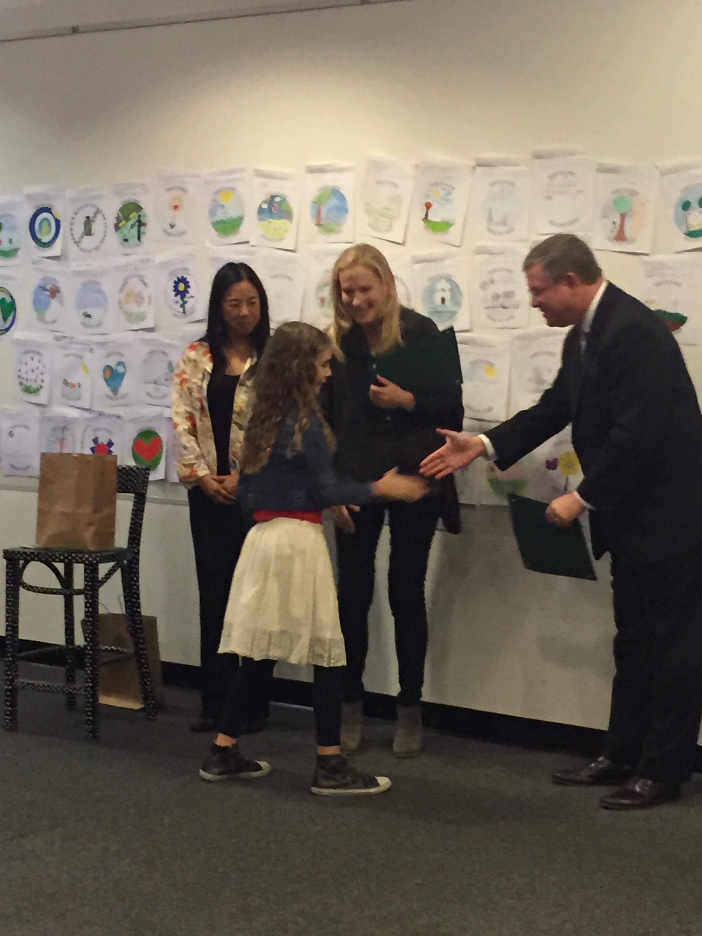 Mattia Gibbs receives her award