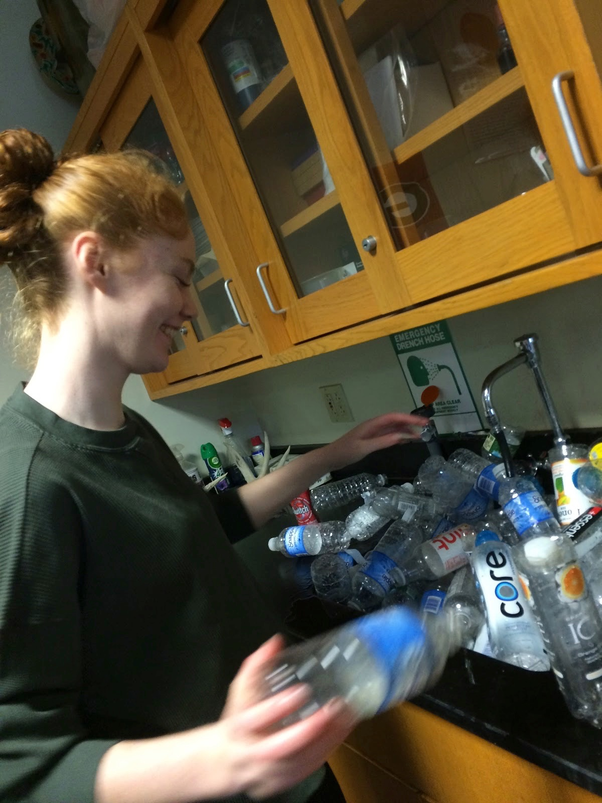 Emma Kelly-Walsh, eighth grader, sorting through collected plastic bottles.