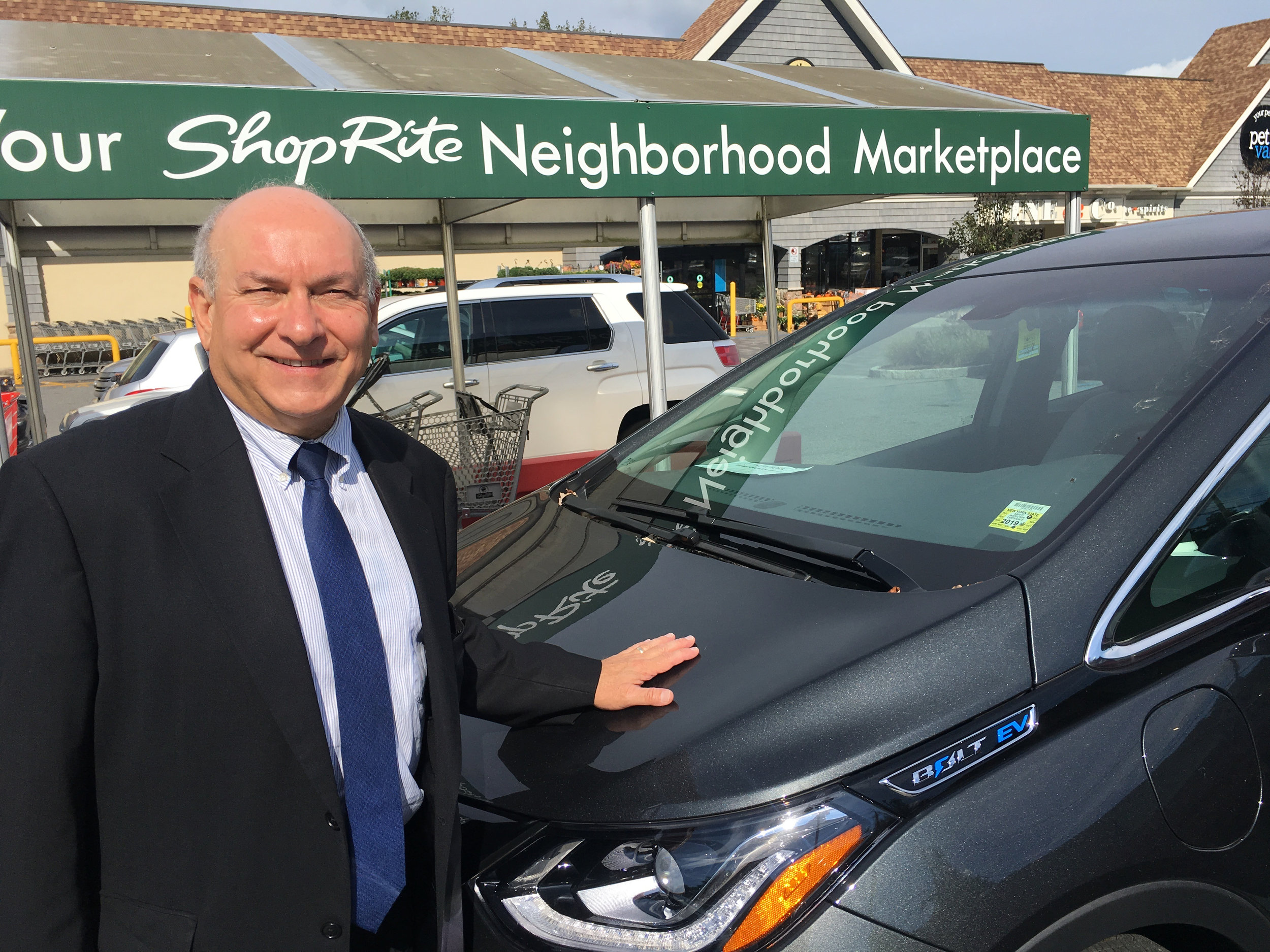 Chris with his Electric Vehicle, the Chevy Bolt