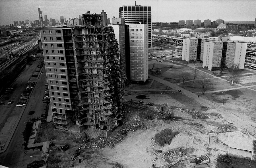 The first building to be demolished at Stateway Gardens with the downtown Chicago skyline in the background.   PHOTO BY PATRICIA EVANS