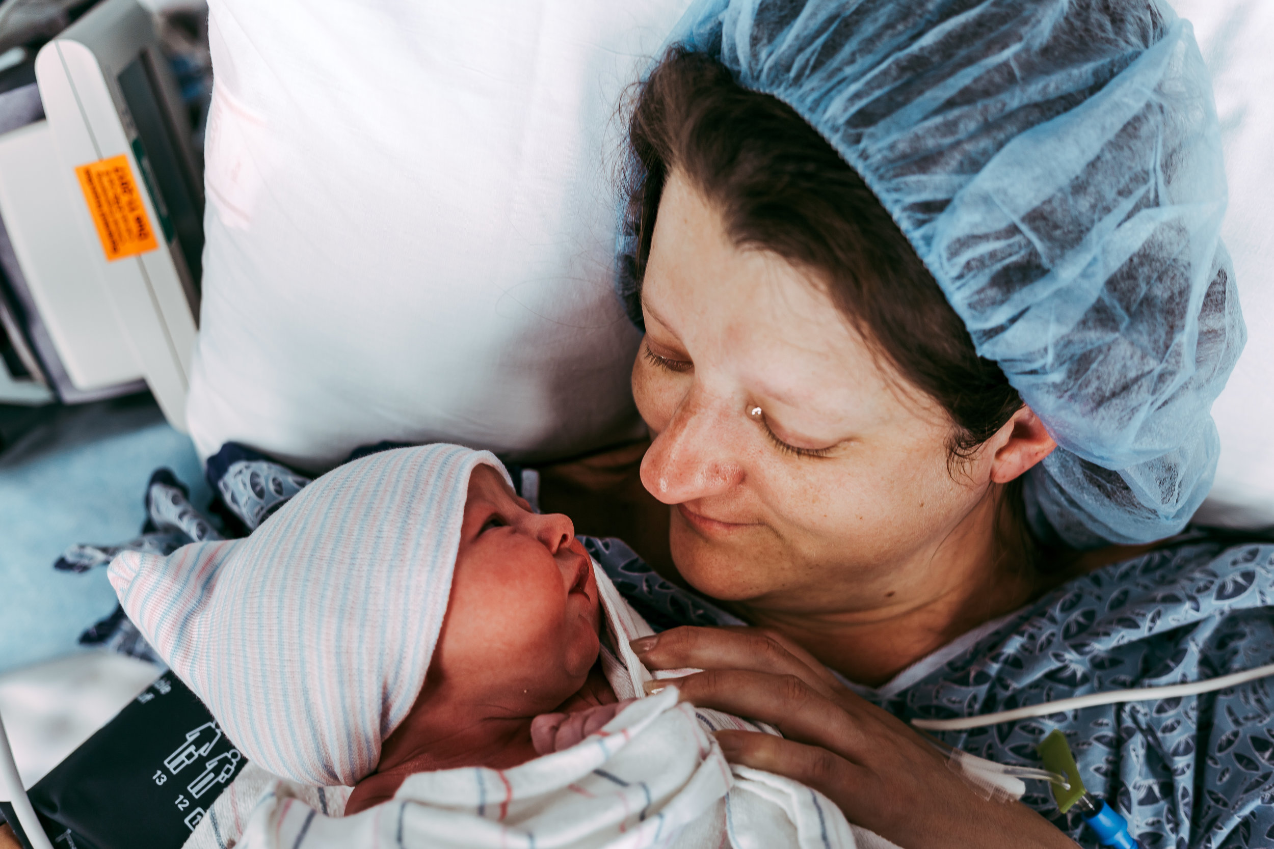 mother and baby gaze into each other's eyes following cesarean birth at Virginia Baptist Hospital in Lynchburg, Virginia
