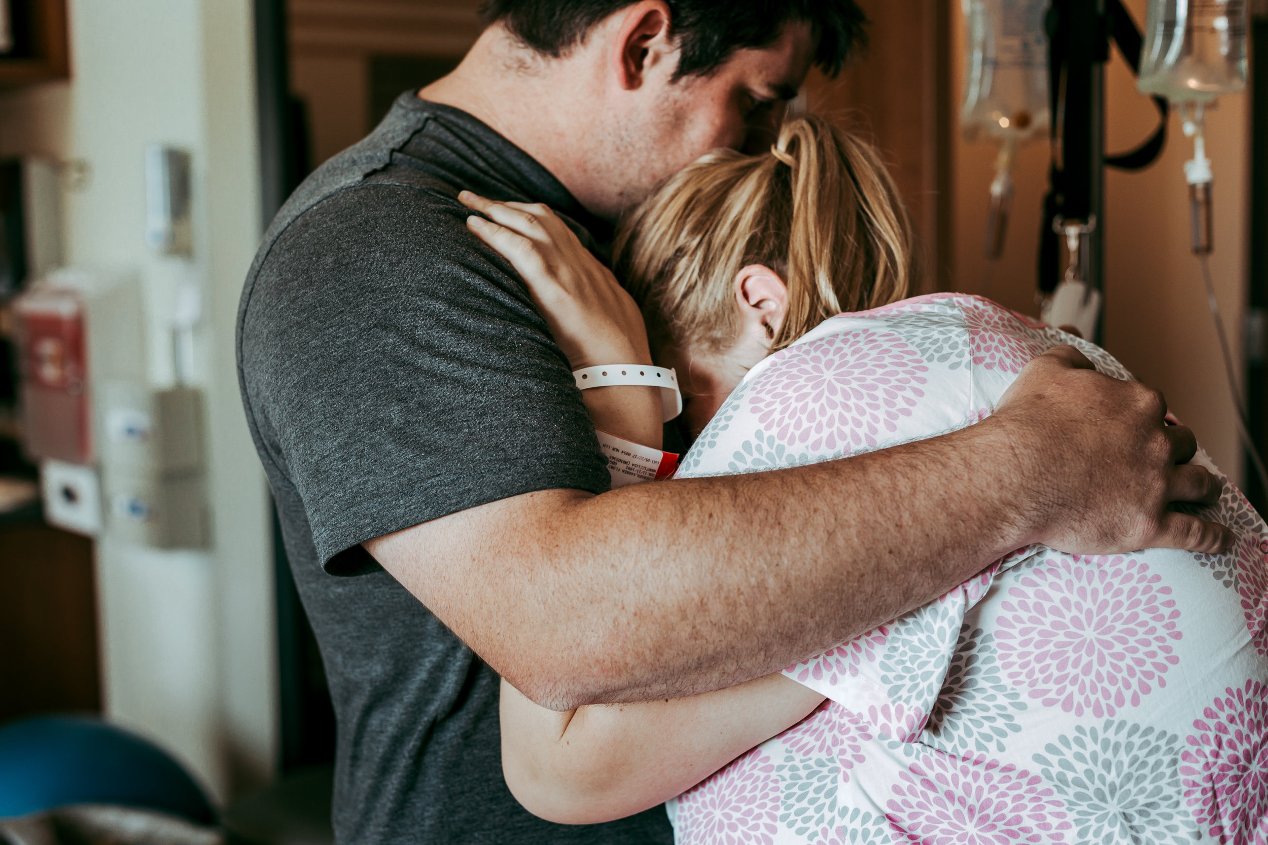 Supportive Husband Comforts Laboring Wife at Augusta Health Labor and Delivery - Fishersville Birth Photographer