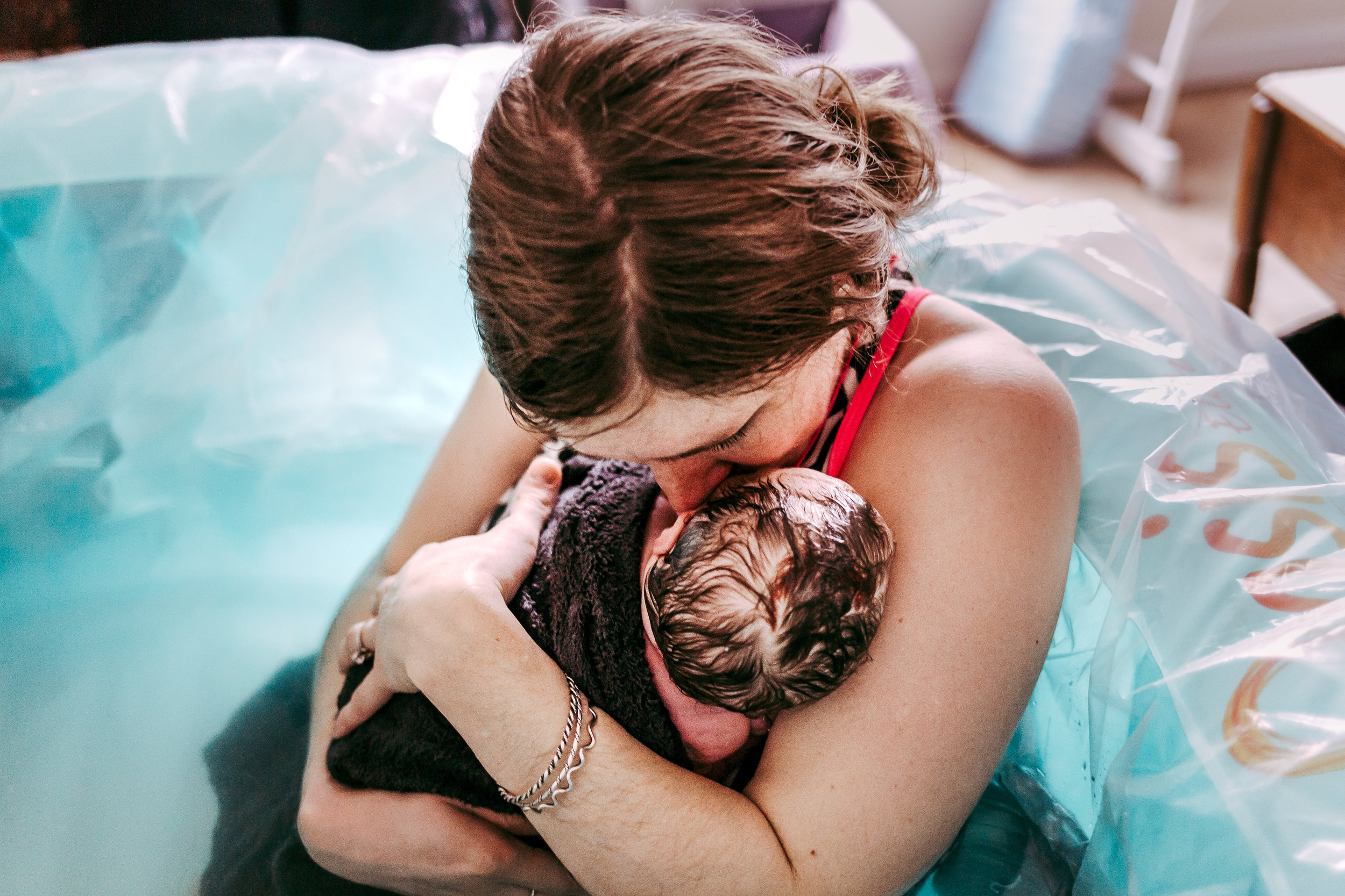 Photo of mom snuggling her baby close - Home Birth Midwives in Lynchburg, Virginia