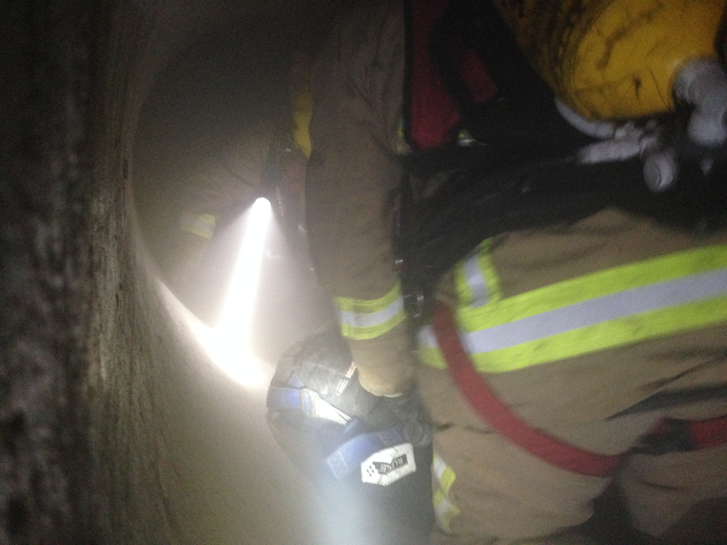 Fire Fighters dragging a casualty (80 kgdummy) through tunnel.