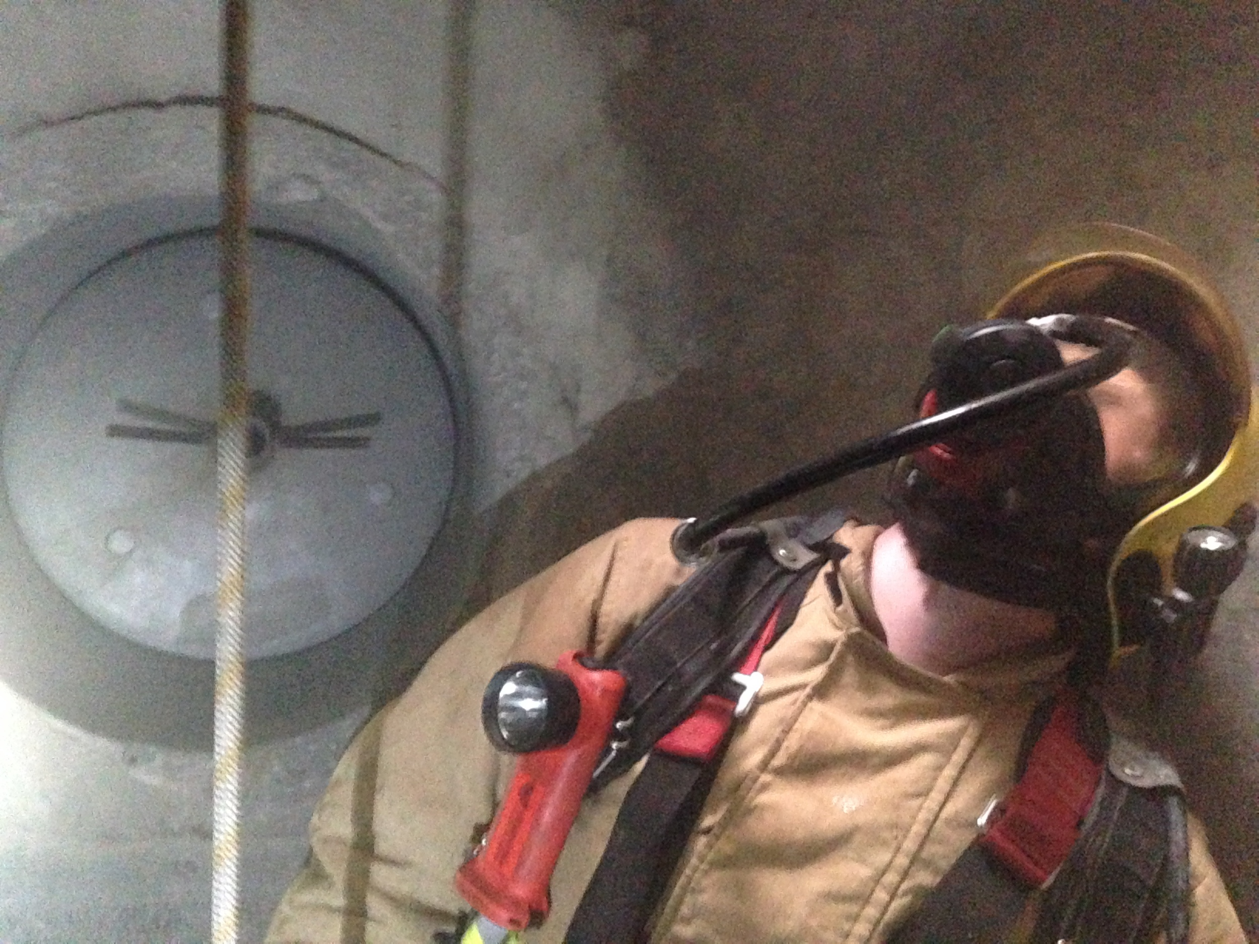 Fire fighter waiting at the bottom of entryshaft.