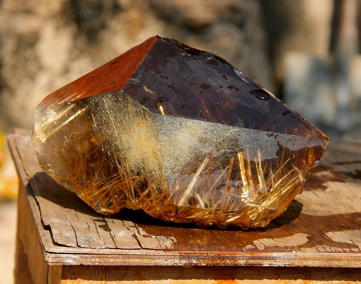 RUTILATED QUARTZ from Bahia. Rutile is a mineral composed mainly of titanium oxide. In quartz, it usually appears as golden, straw-like or wispy inclusions, although colour and form vary. This exceptional piece weighs in at a hefty 2.8 kg.