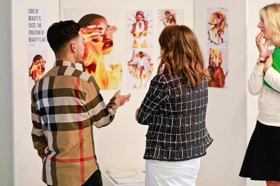 Brett showing his work to Alexandra Shulman, former Editor of British Vogue