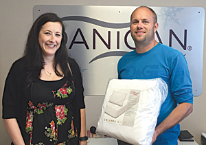 Traci Walker, Resident Services Coordinator for Housing Authority of SLO (HASLO) receives donations of Danican Care Packages from Thomas Frismodt, CEO of Danican.