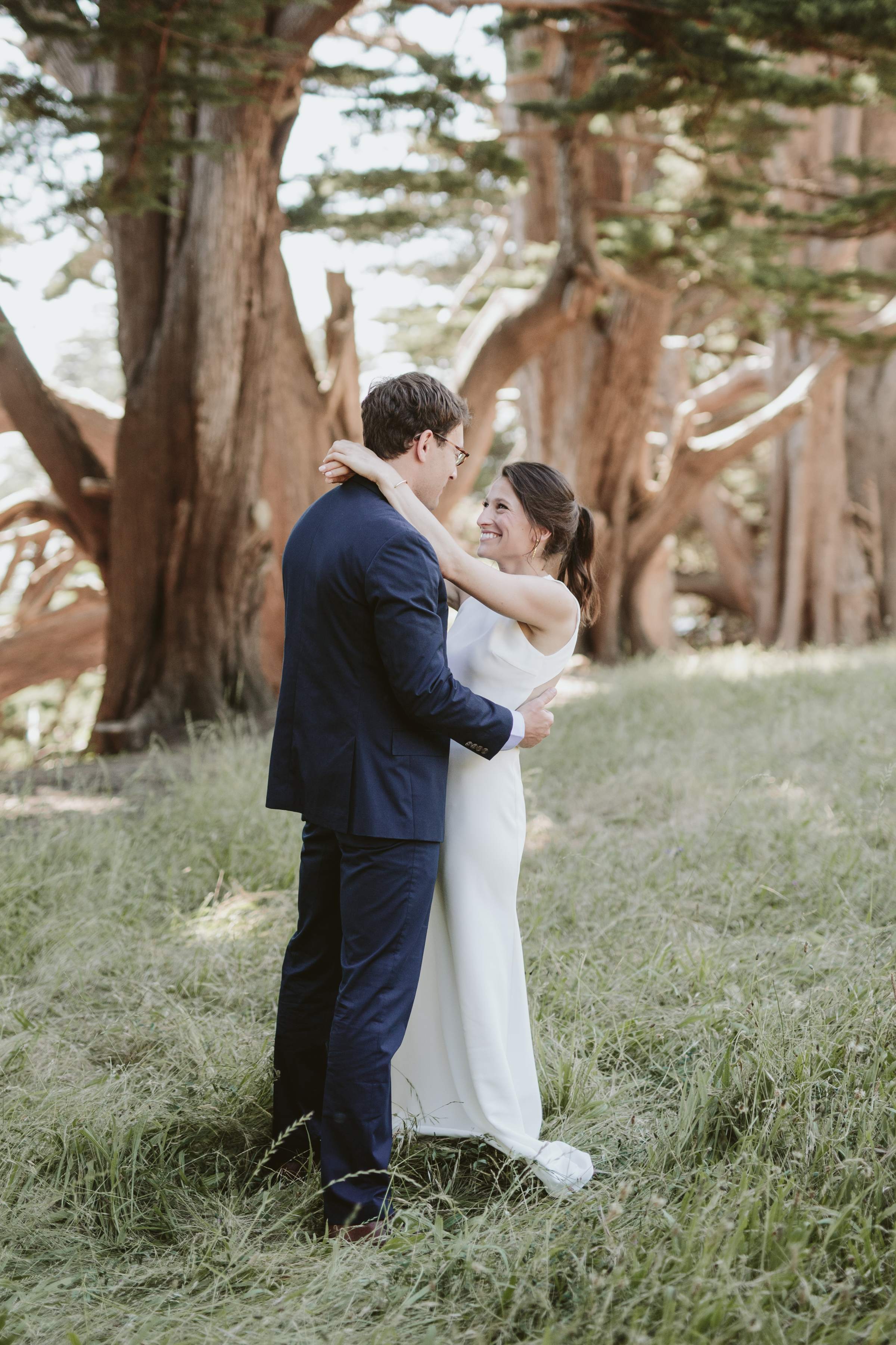 a bride and groom kissing Slide Ranch Wedding