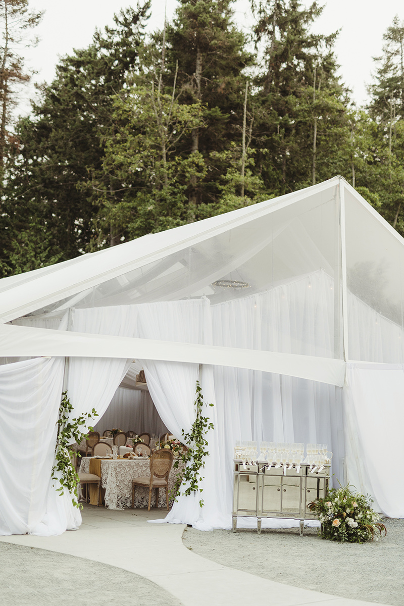 white tents wedding with lots of greenery