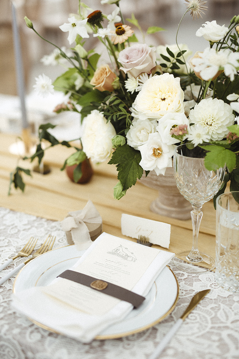 romantic table scape with white, green and orange flowers