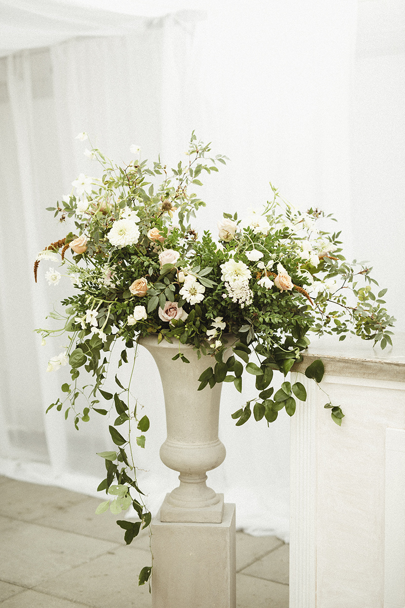 large urn flower arrangement for a wedding