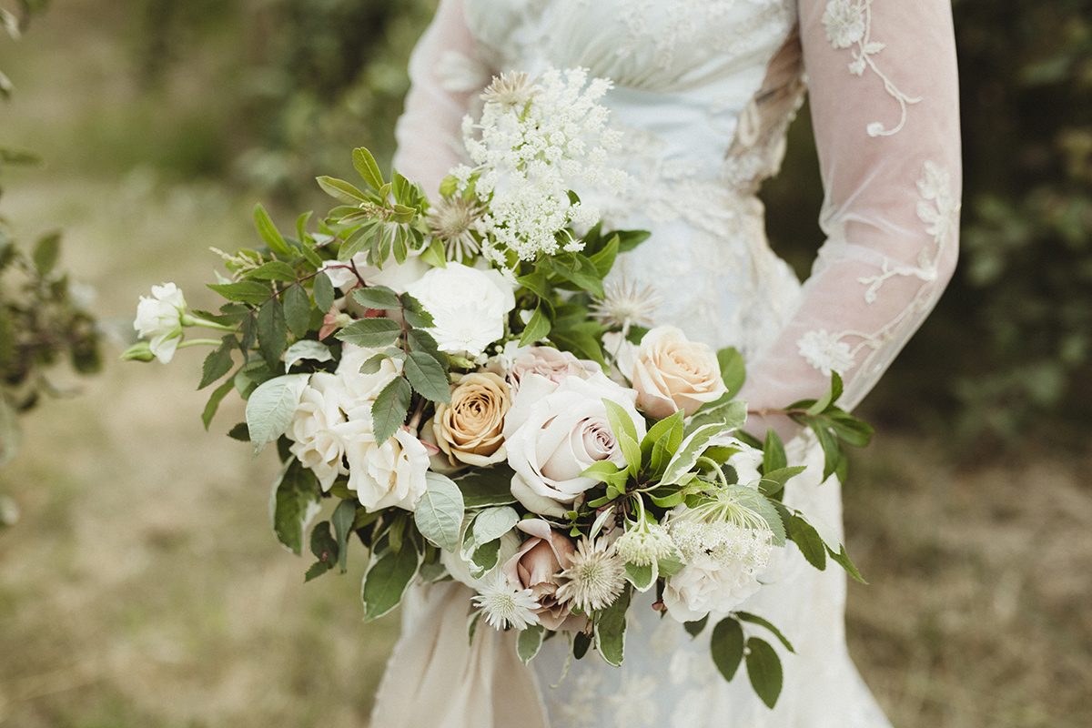 wedding bouquet in pinks and orange - sea cider wedding vancouver island wedding photographer