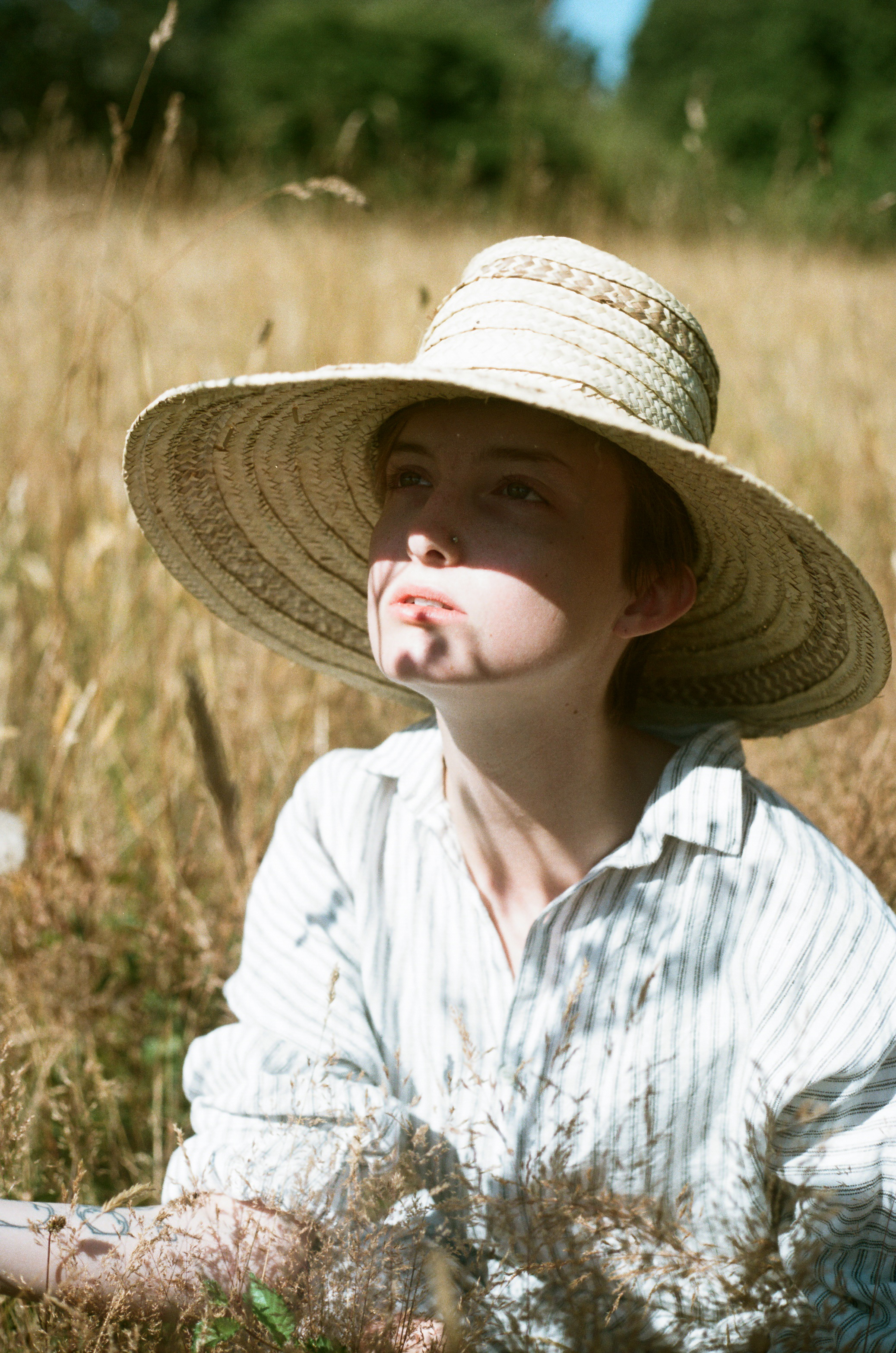 girl in straw hat in a grassy field, victoria bc fashion editorial OPEN HOUSE
