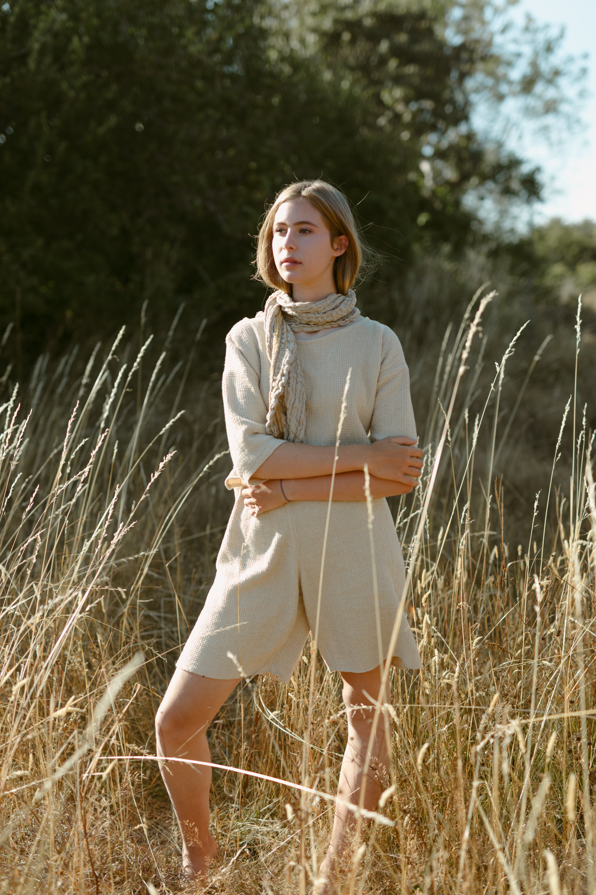 girl in a grass field, fashion photography, handwoven clothing woven wares victoria bc