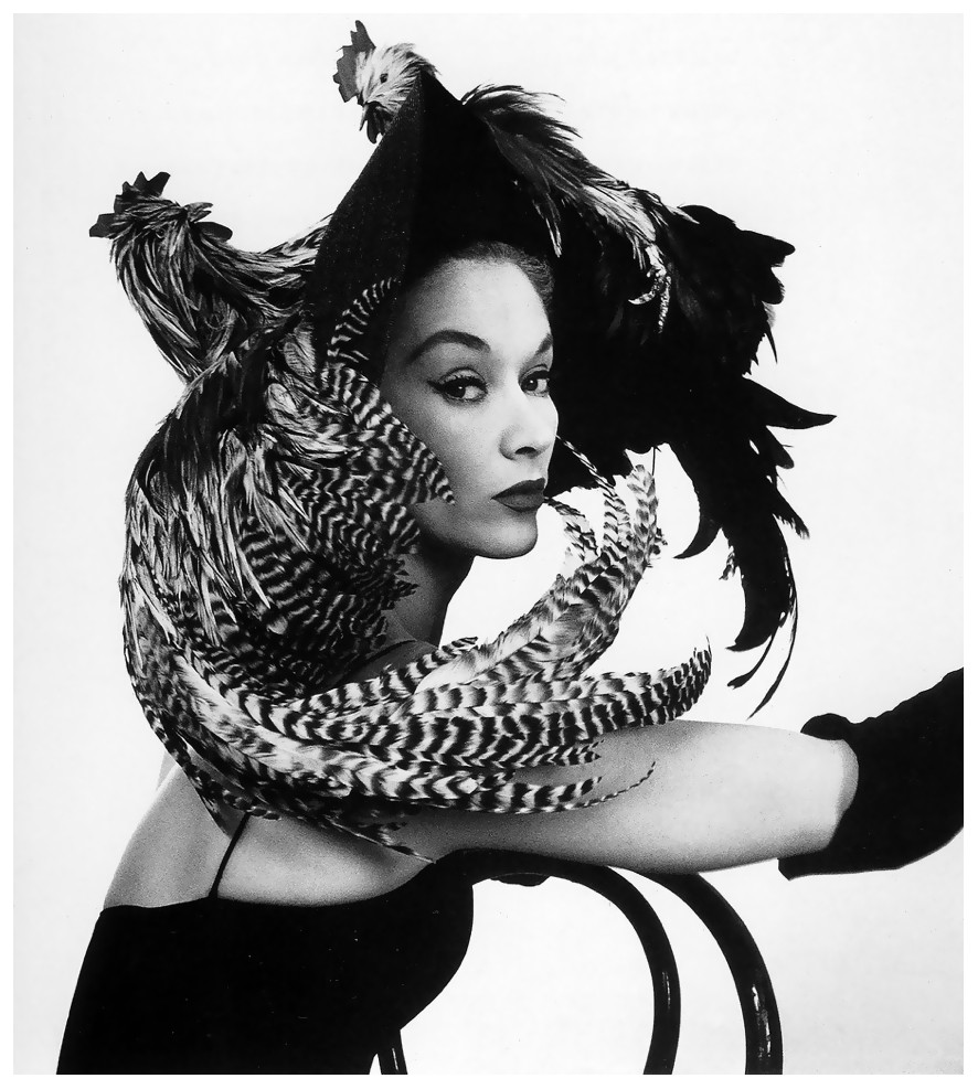 Woman in a chicken hat photographed by Irving Penn.