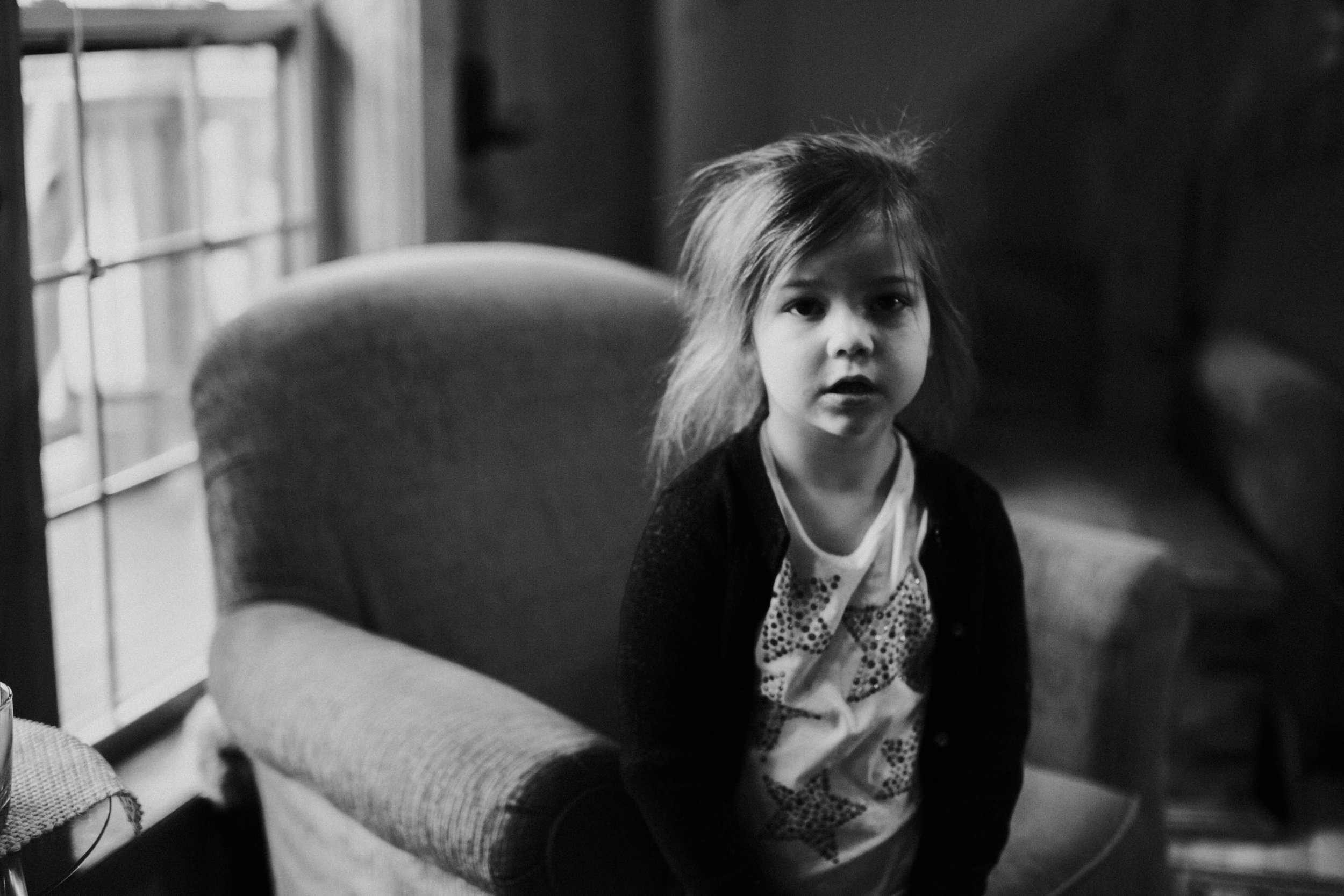 Christmas 2016 | Hannahill Photography | Branson, MO | Documentary Family Photography | Black and white portrait of my niece by the window