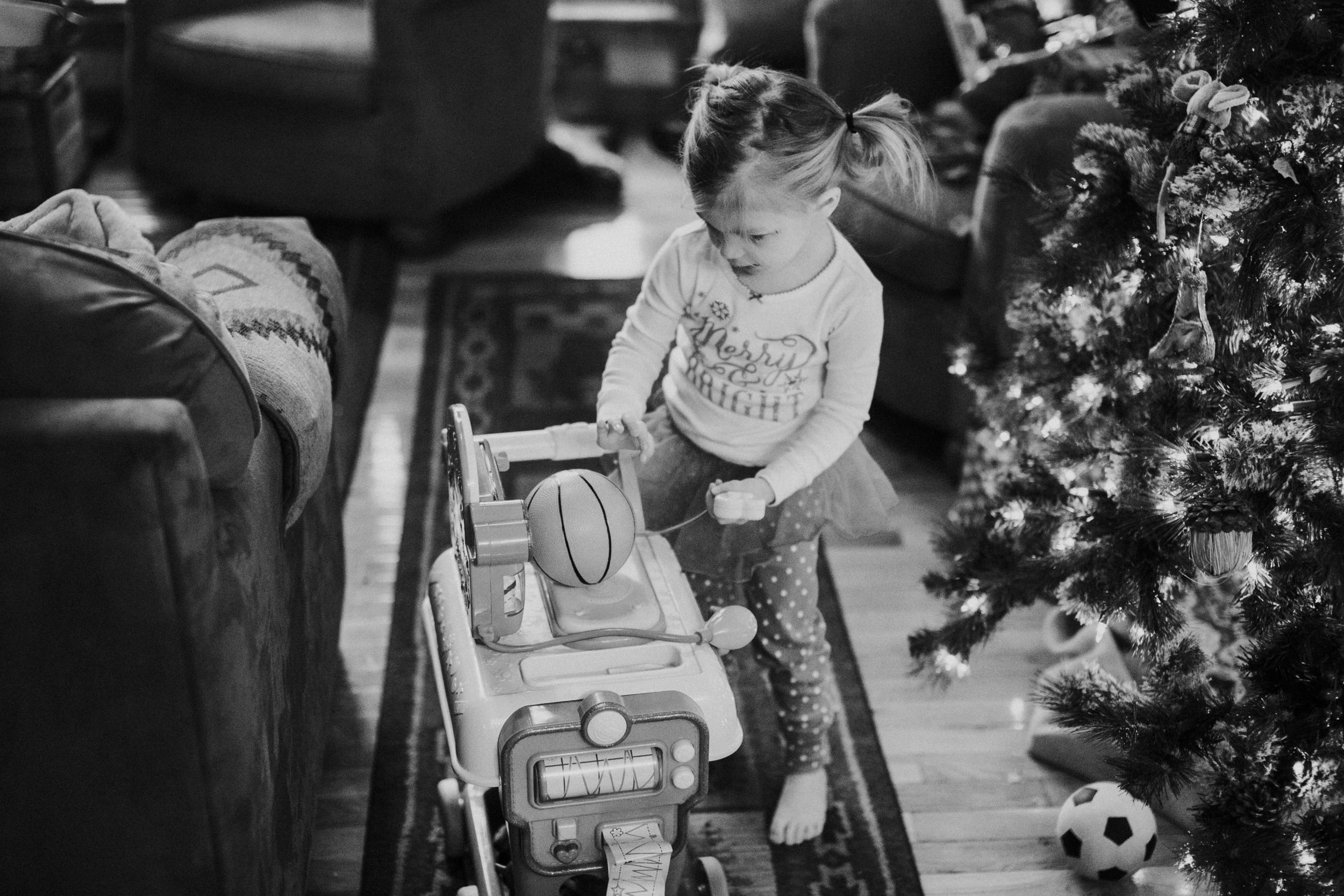 Christmas 2016 | Hannahill Photography | Branson, MO | Documentary Family Photography | a black and white portrait of my niece with her new toys