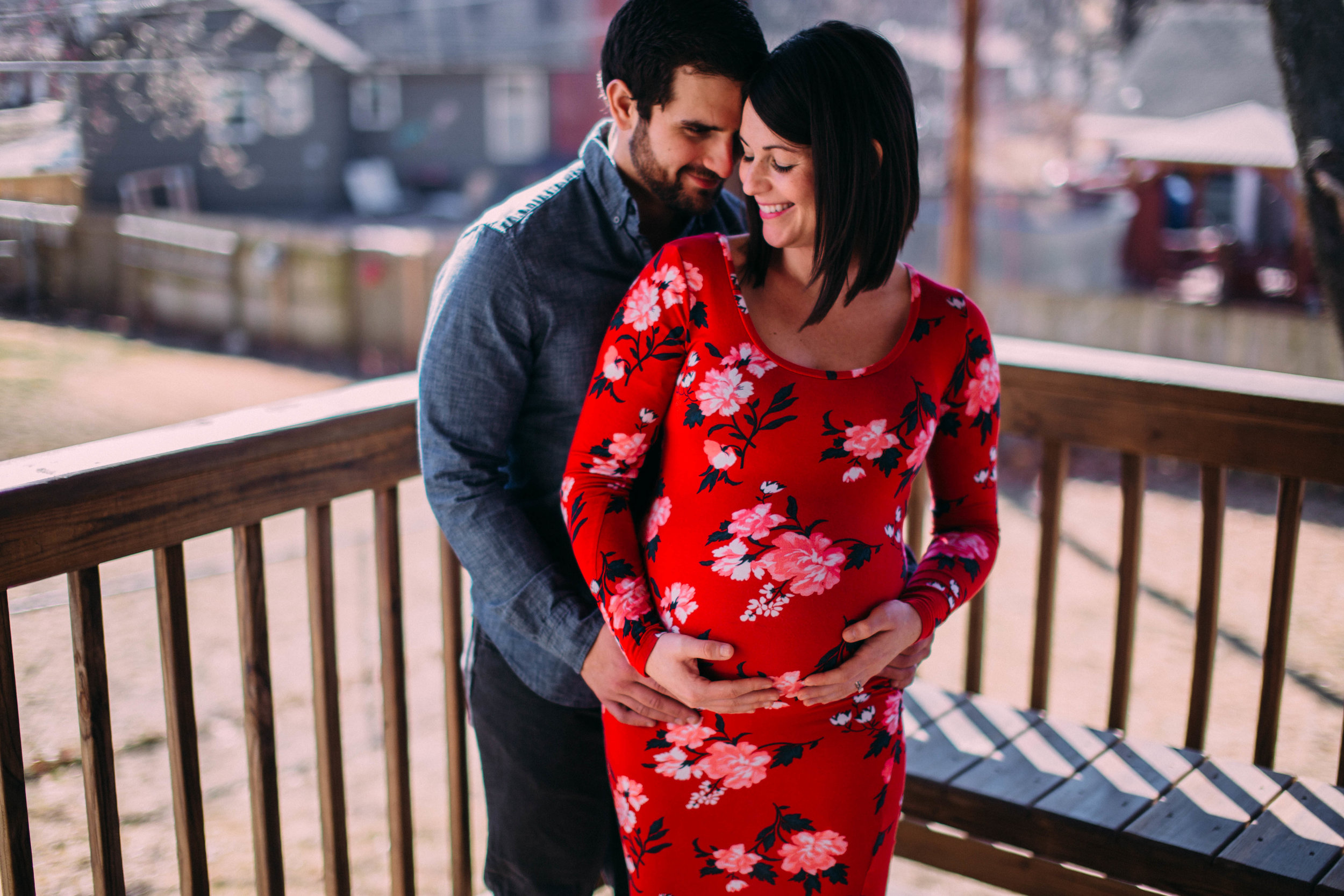 Claire & Brandon : Baby-moon Session | Lifestyle Maternity | Hannahill Photography | Kansas City, MO | In home session celebrating a pregnant momma and an excited dad | bright floral dress | playing catch with the pups | February Session | Baby Nursery elegant and stylish