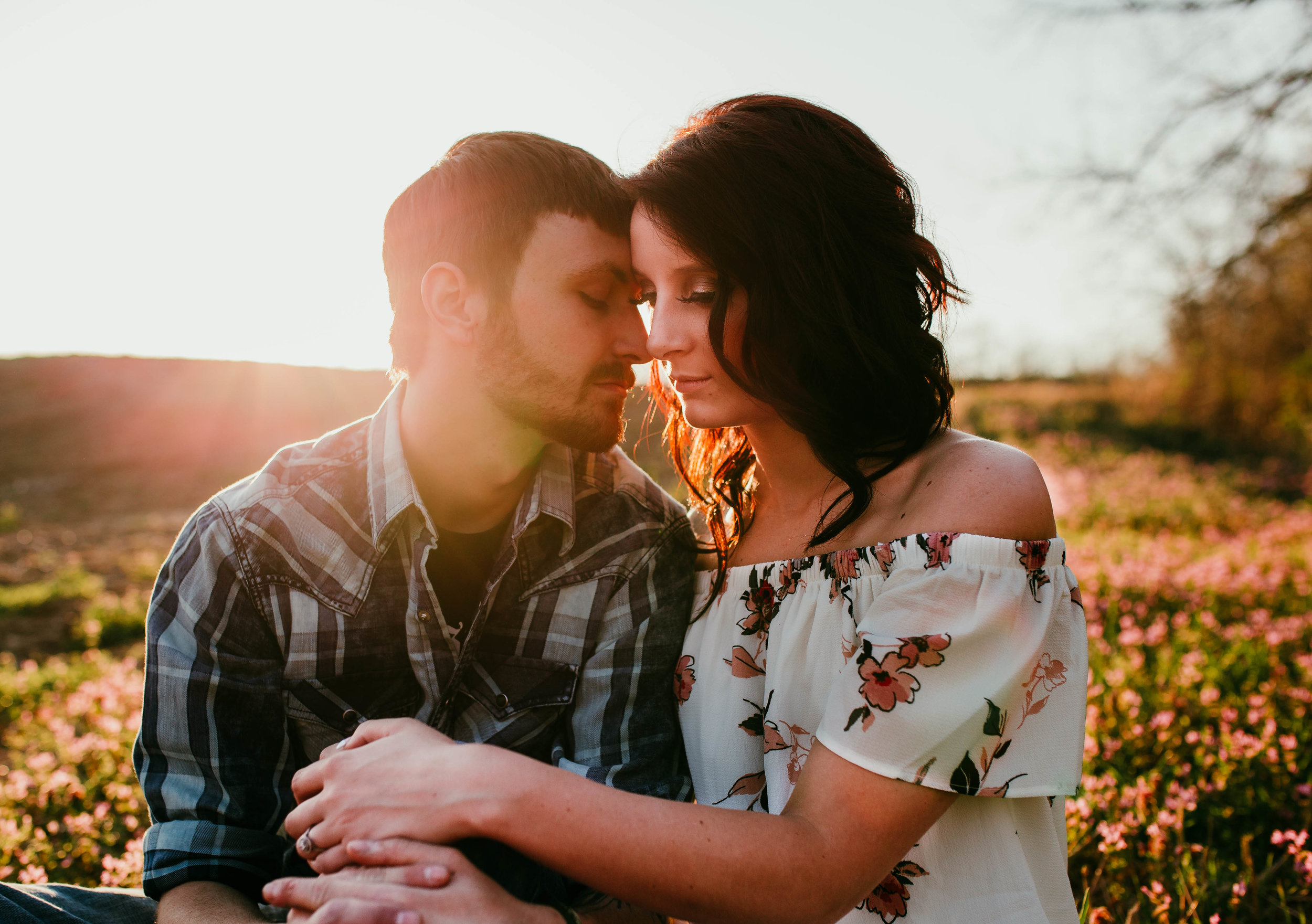 Dalton & Alexa Lexington, MO Engagement | Hannahill Photography | Kansas City Photographer | engaged couple adventure session | wedding photography midwest | chasing light | floral dress engagement session | sunset session | Big river ranch, Lexington, Mo