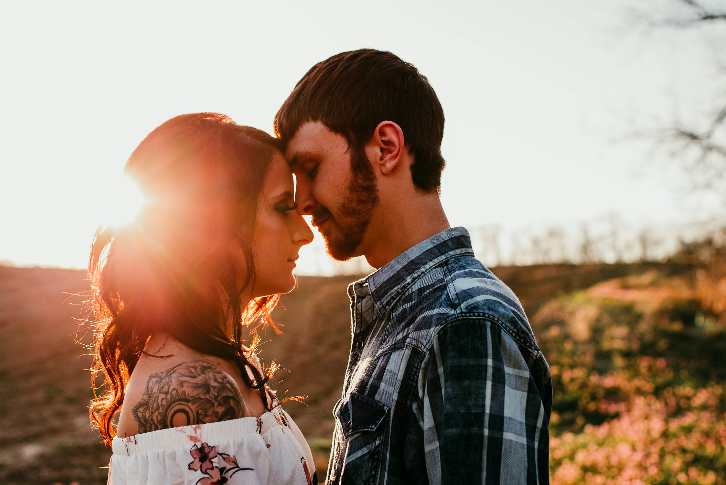 Dalton & Alexa Lexington, MO Engagement | Hannahill Photography | Kansas City Photographer | engaged couple adventure session | wedding photography midwest | chasing light | floral dress engagement session | sunset session | Big river ranch, Lexington, Mo