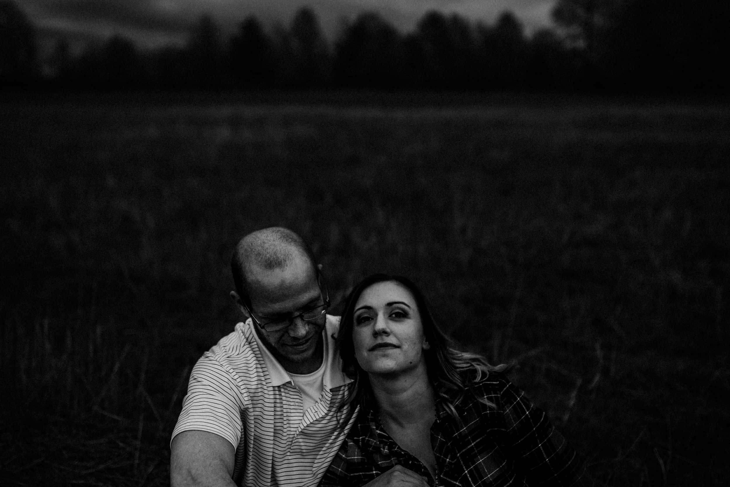 Kristin & Travis Lee's Summit, Mo Engagement | Hannahill Photography | Kansas City, MO | Engagement session | Kansas City wedding photographer | Raleigh wedding photographer | Raleigh photographer | durham engagement photographer | North Carolina wedding photographer | north Carolina | Greensboro | chapel hill photographer | midwest photographer | east coast photographer | wedding photography | engaged | she said yes | love story | lifestyle photographer | artistic and emotive photography | black and whites | dramatic art photography | woodland session | adventure session | greens cloudy days spring session
