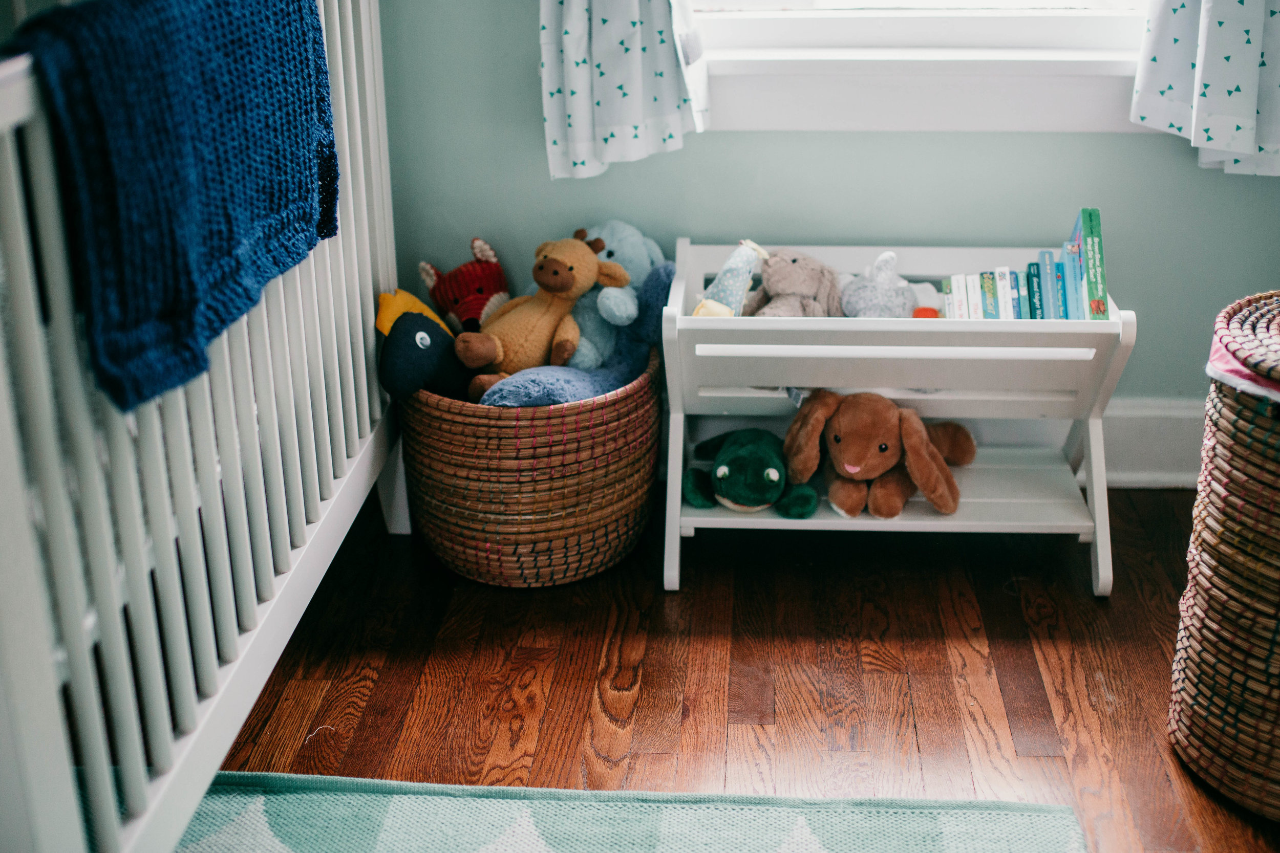 A shot of the adorable mint colored eclectic nursery |Paul O Lifestyle Newborn Session | Hannahill Photogrraphy | Kansas City, MO
