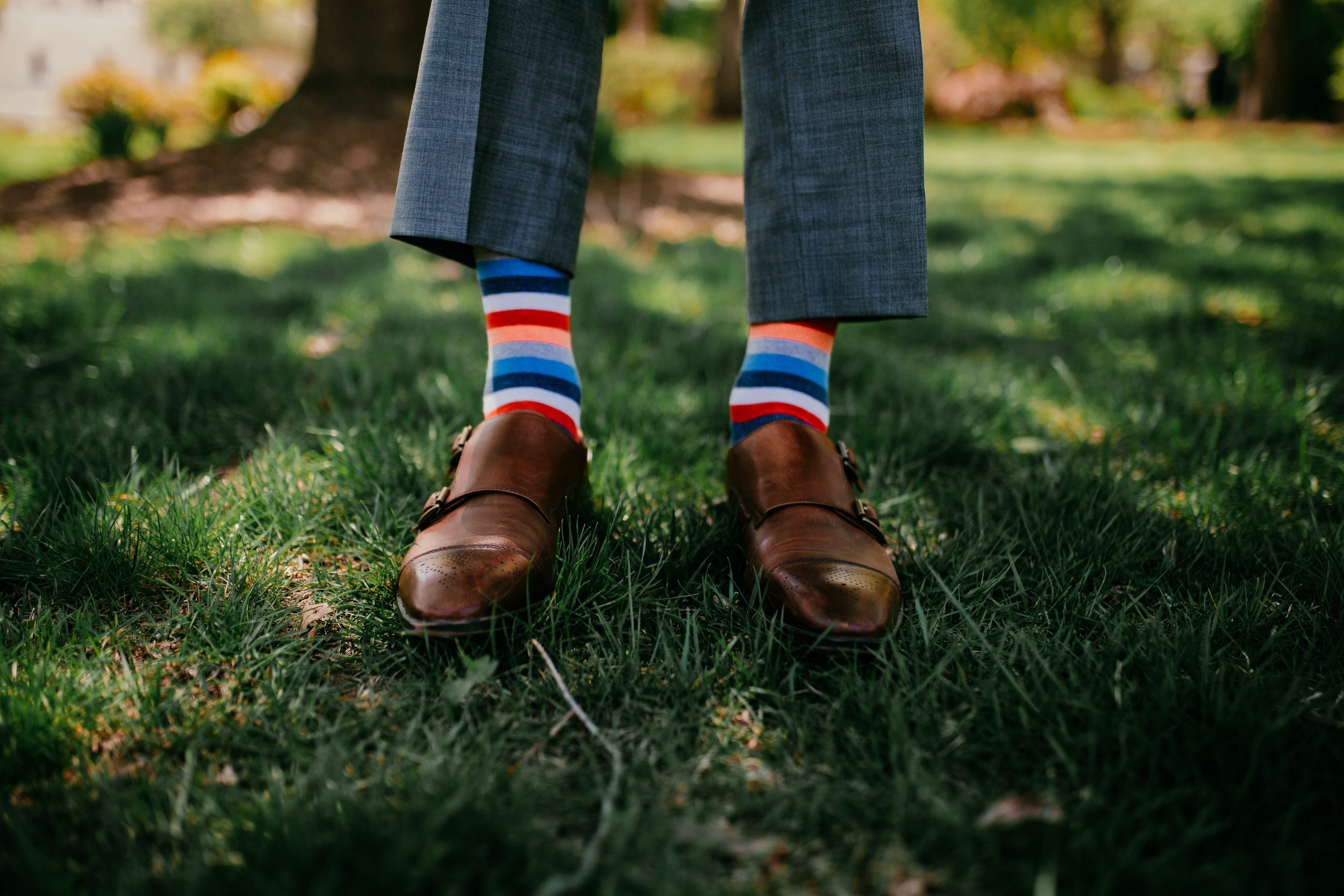 Bert & Lauren's North Kansas City Spring Wedding | Hannahill Photography | Raleigh Durham Photographer | North Carolina Wedding Photography | Family Photographer | Wedding photographer | the grooms colorful socks for the day of the wedding