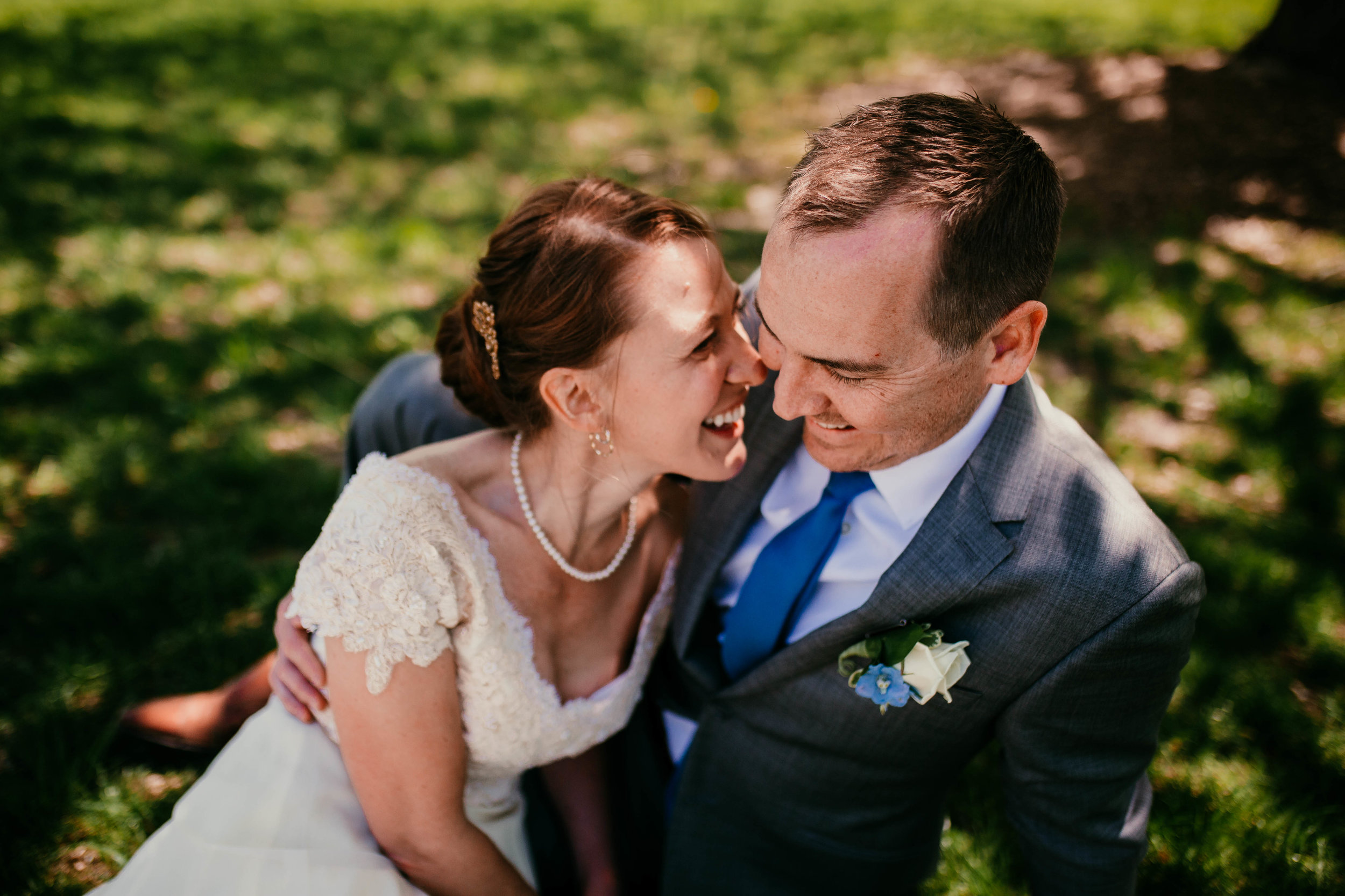 Bert & Lauren's North Kansas City Spring Wedding | Hannahill Photography | Raleigh Durham Photographer | North Carolina Wedding Photography | Family Photographer | Wedding photographer | the bride and groom cuddle together in color
