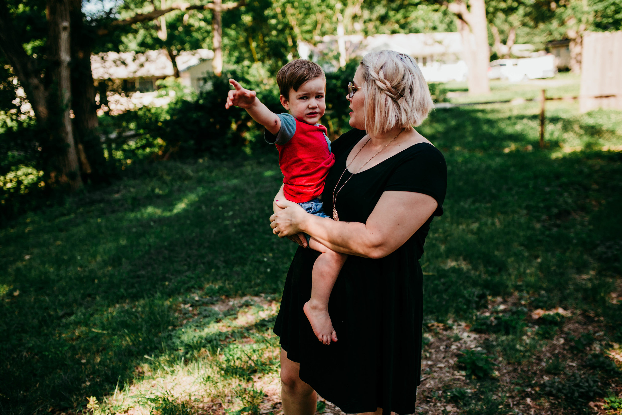 Mom comforts her youngest in the backyard  The Carter Family : Summer in the Backyard | Hannahill Photography | Kansas City, MO | Family photography lifestyle photographer | Wedding photographer Durham North Carolina Raleigh | Birth photographer Documentary