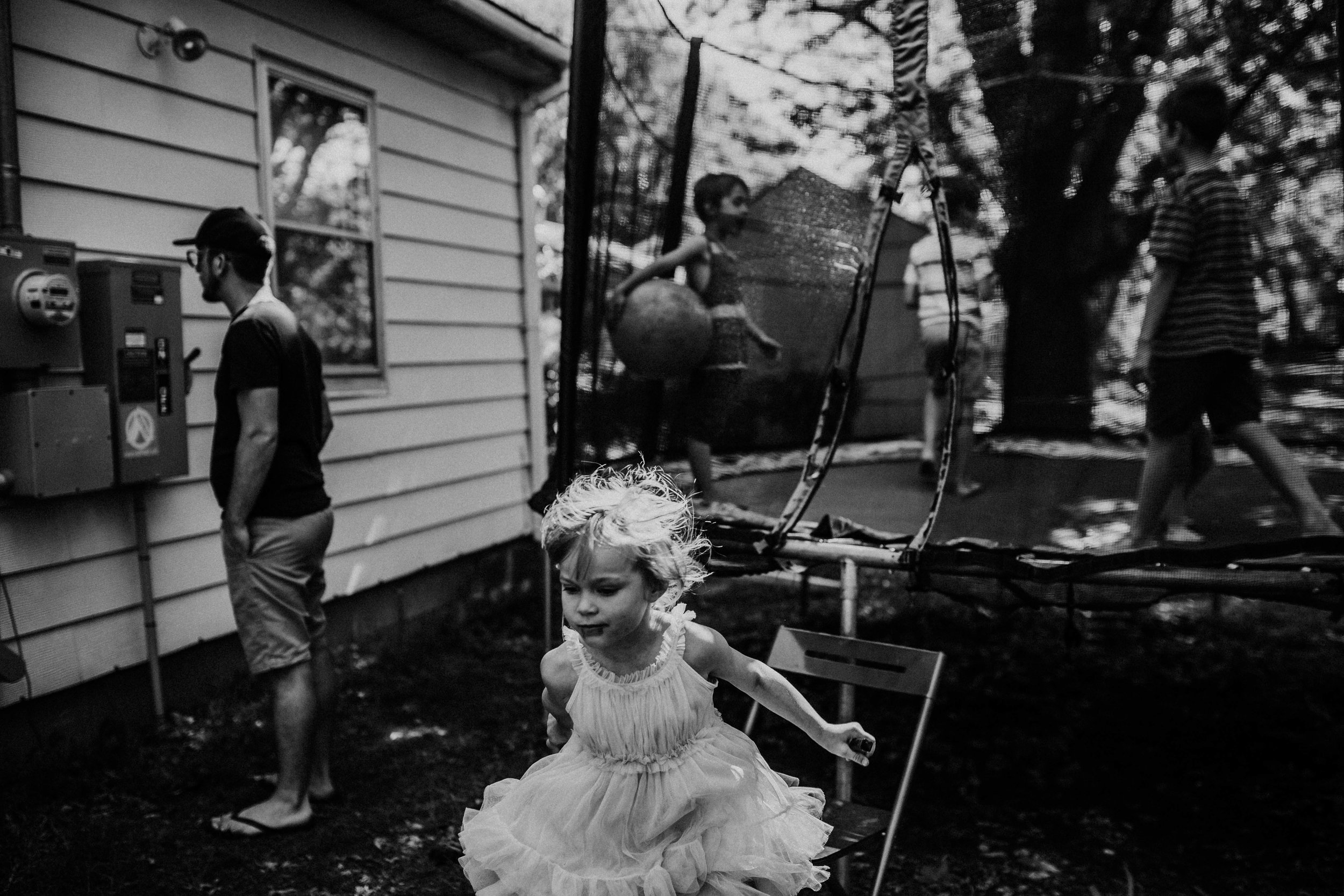 Jumping from the trampoline in black and white.   The Carter Family : Summer in the Backyard | Hannahill Photography | Kansas City, MO | Family photography lifestyle photographer | Wedding photographer Durham North Carolina Raleigh | Birth photographer Documentary