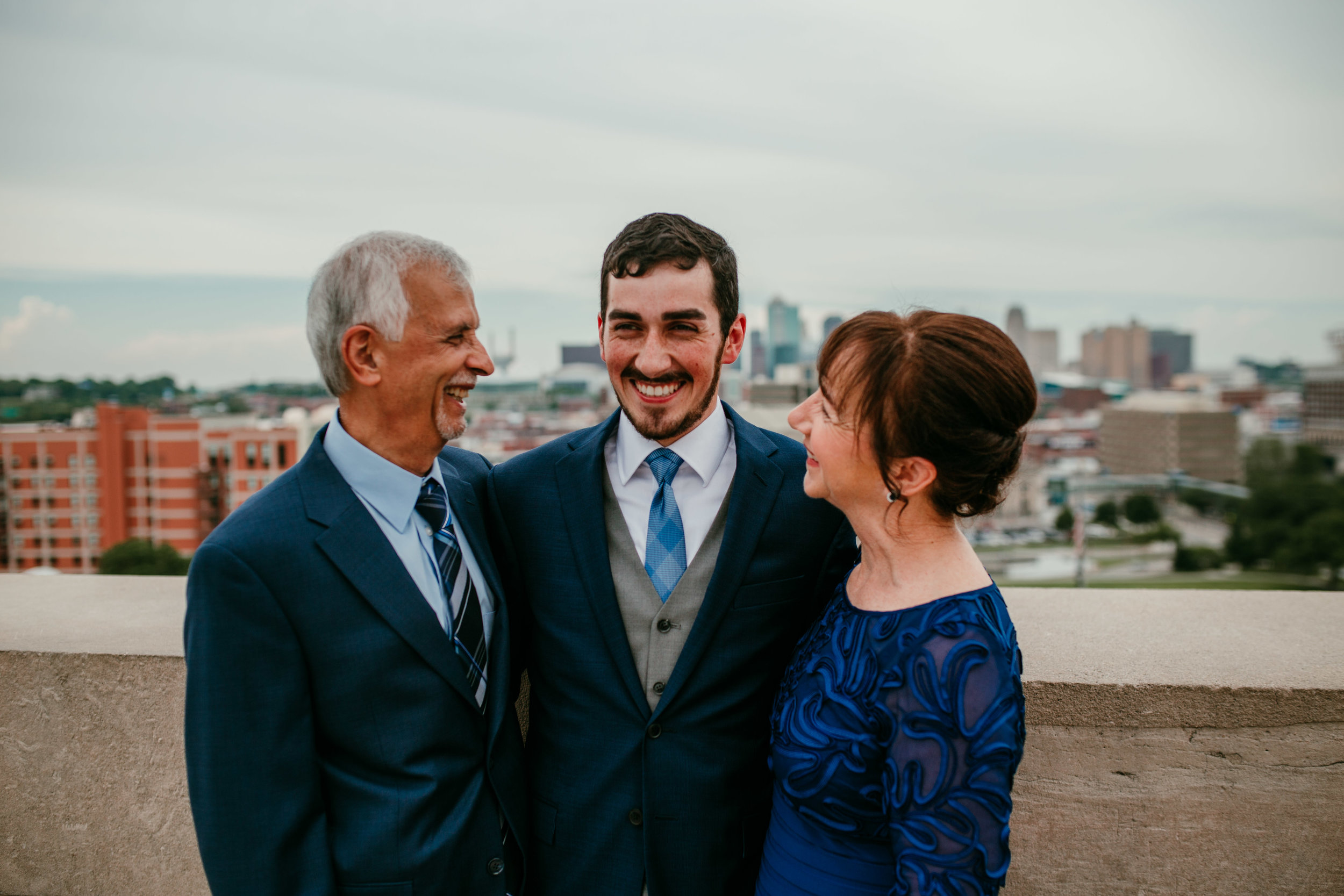 Family portraits at Liberty Memorial Skyline Downtown Kansas City | Shelbie & Jospeh's Summer Love Story : Kansas City Wedding | Hanna Hill Photography