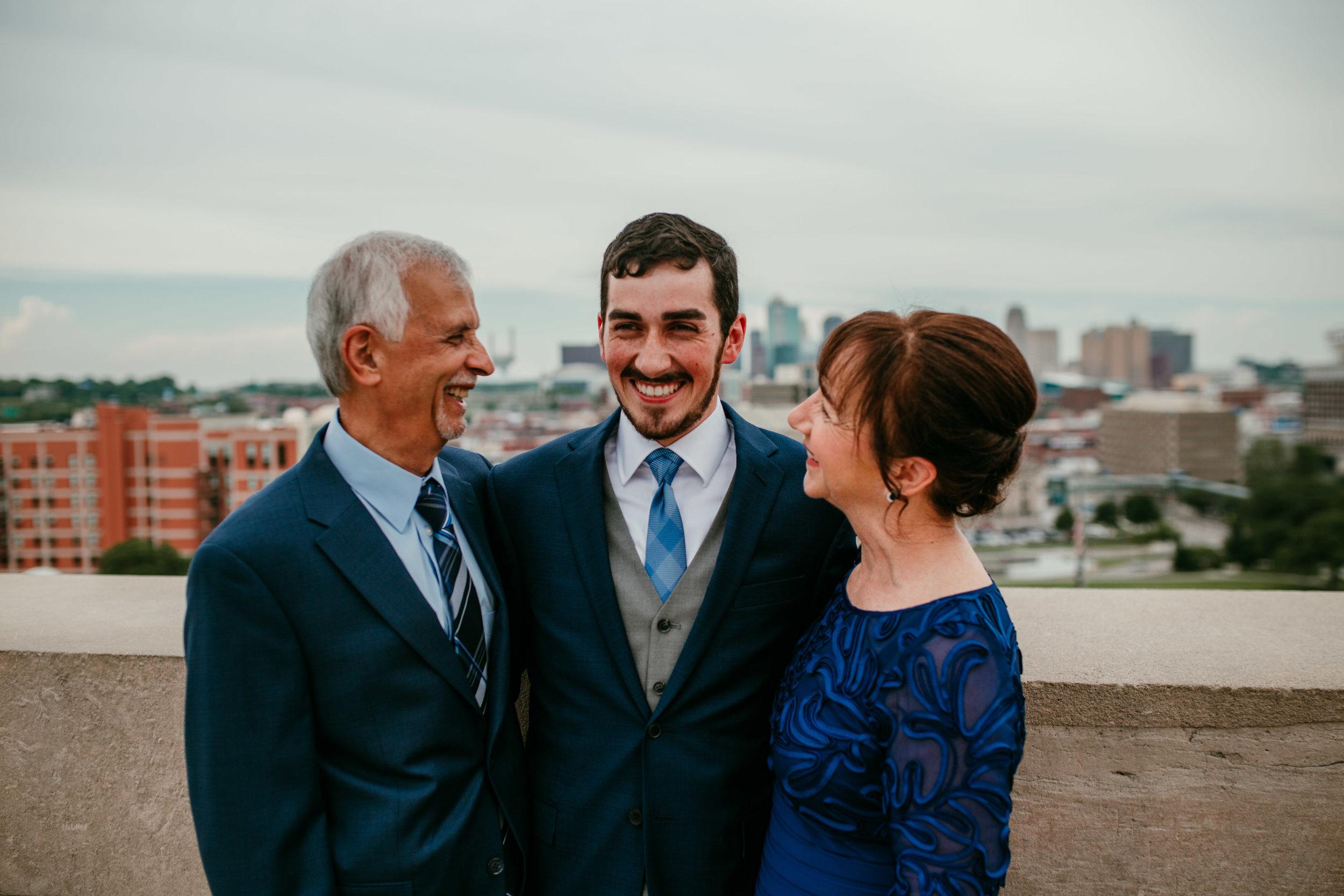 Family portraits at Liberty Memorial Skyline Downtown Kansas City   Shelbie & Jospeh's Summer Love Story : Kansas City Wedding   Hanna Hill Photography