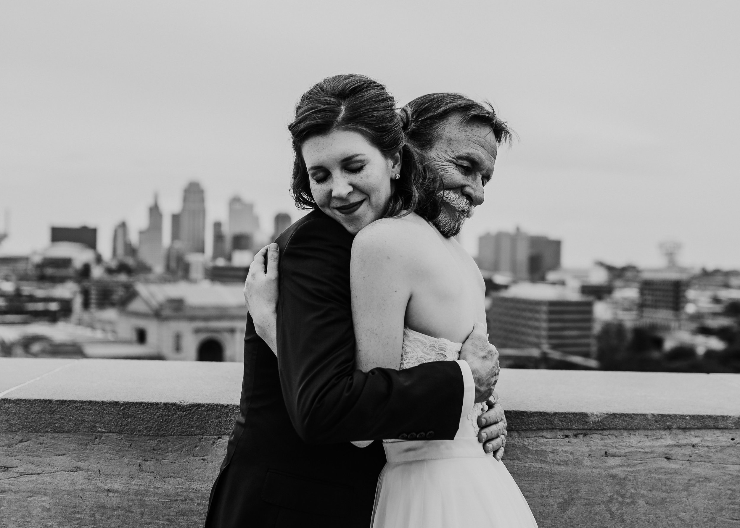 Family Portraits at Liberty Memorial skyline   Father and daughter  Shelbie & Jospeh's Summer Love Story : Kansas City Wedding   Hanna Hill Photography