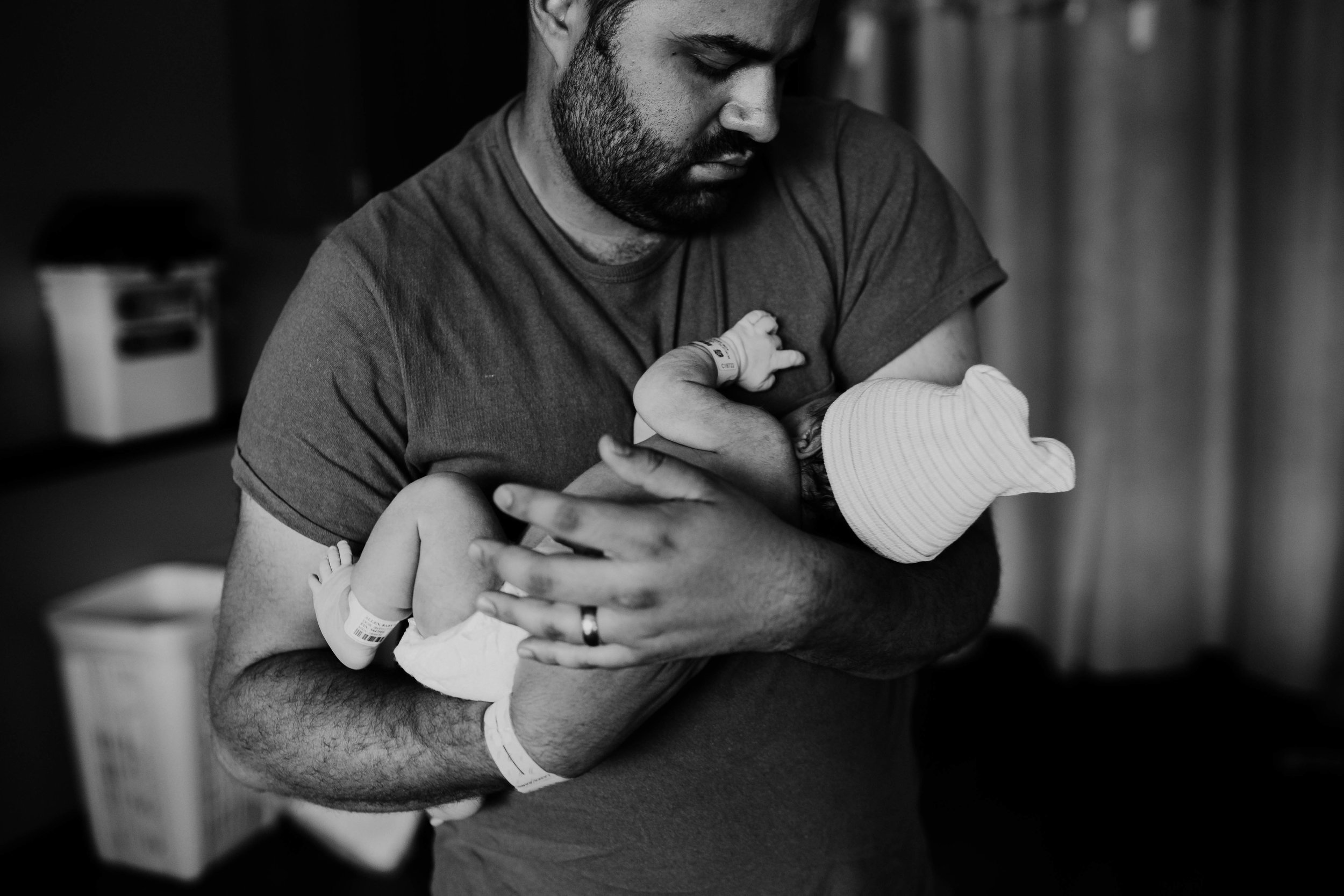 father holds his son in black and white | Luca A. Birth Story | Durham/Raleigh, NC | Hanna Hill Photography