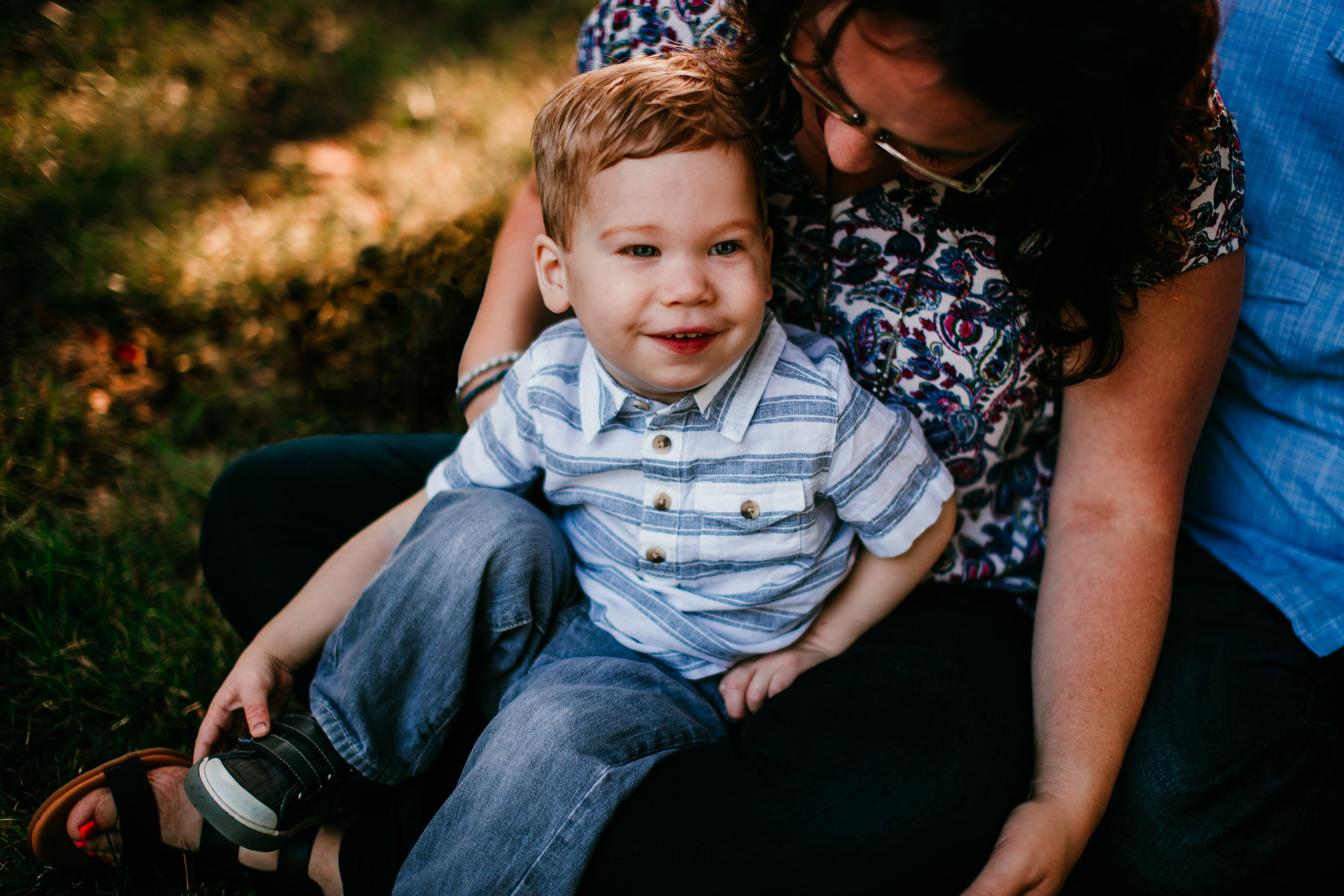 Little boy sits in mom's lap at the park for family portraits | The Hann Family | Hanna Hill photography | Durham, NC Family Photographer